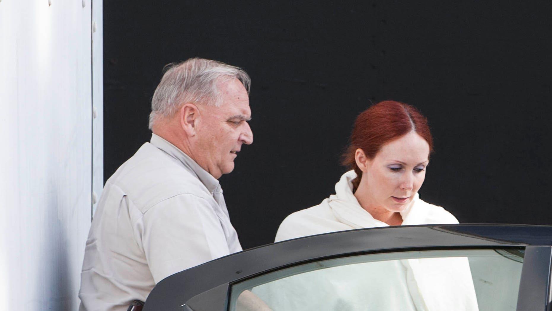 File - In this June 7, 2013 file photo, Shannon Richardson is placed into a Titus County Sheriff's car after an initial appearance at the federal building Texarkana, Texas.  A federal grand jury has indicted an Richardson, who authorities say sent ricin-laced letters to President Barack Obama and others in an attempt to frame her estranged husband. (AP Photo/The Texarkana Gazette, Curt Youngblood, File) MANDATORY CREDIT