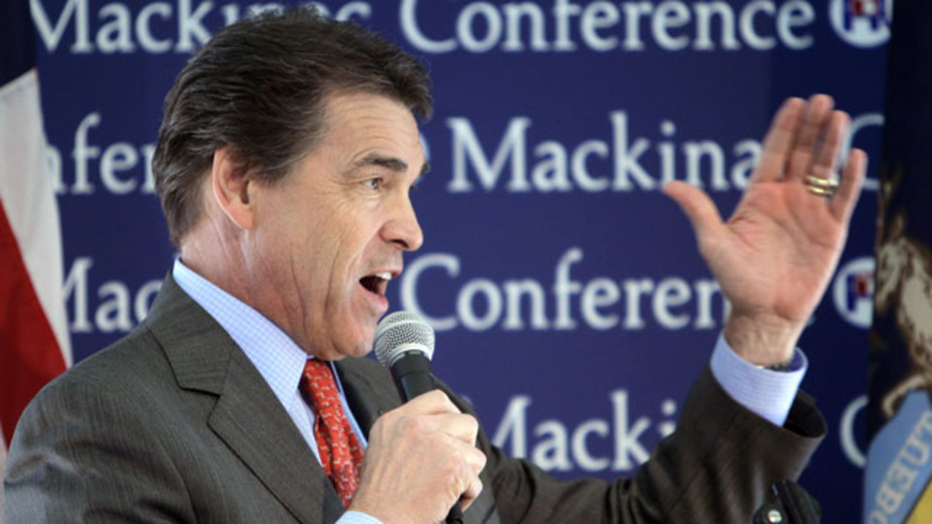 September 24: Republican presidential candidate Texas Gov. Rick Perry addresses the Republican Leadership Conference at the Grand Hotel on Mackinac Island, Mich.