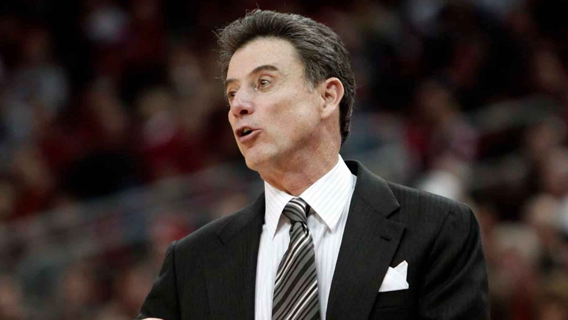 Louisville coach Rick Pitino gives instructions to his team in their NCAA college basketball game against Gardner-Webb in Louisville, Ky., Saturday, Dec. 18, 2010. No. 20 Louisville beat Gardner-Webb 78-49.  (AP Photo/Garry Jones)