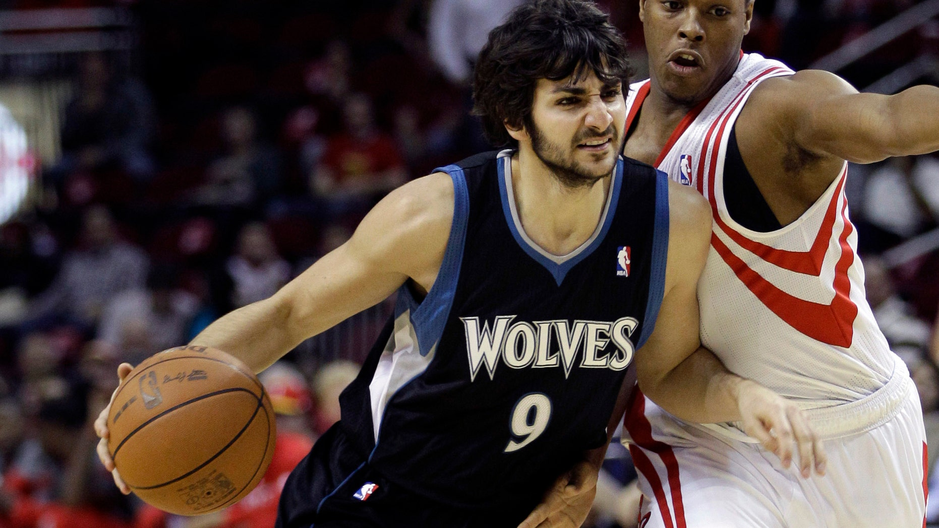 Minnesota Timberwolves' Ricky Rubio drives toward the basket as Houston Rockets' Kyle Lowry, right, defends during the first quarter of an NBA basketball game on Friday in Houston. (AP Photo/David J. Phillip)