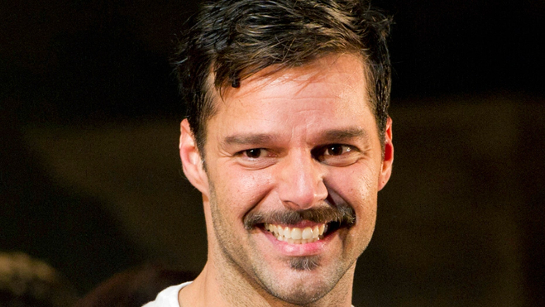 """March 12, 2012: Ricky Martin appears at the curtain call after his first performance in the new Broadway production of """"Evita"""", in New York."""
