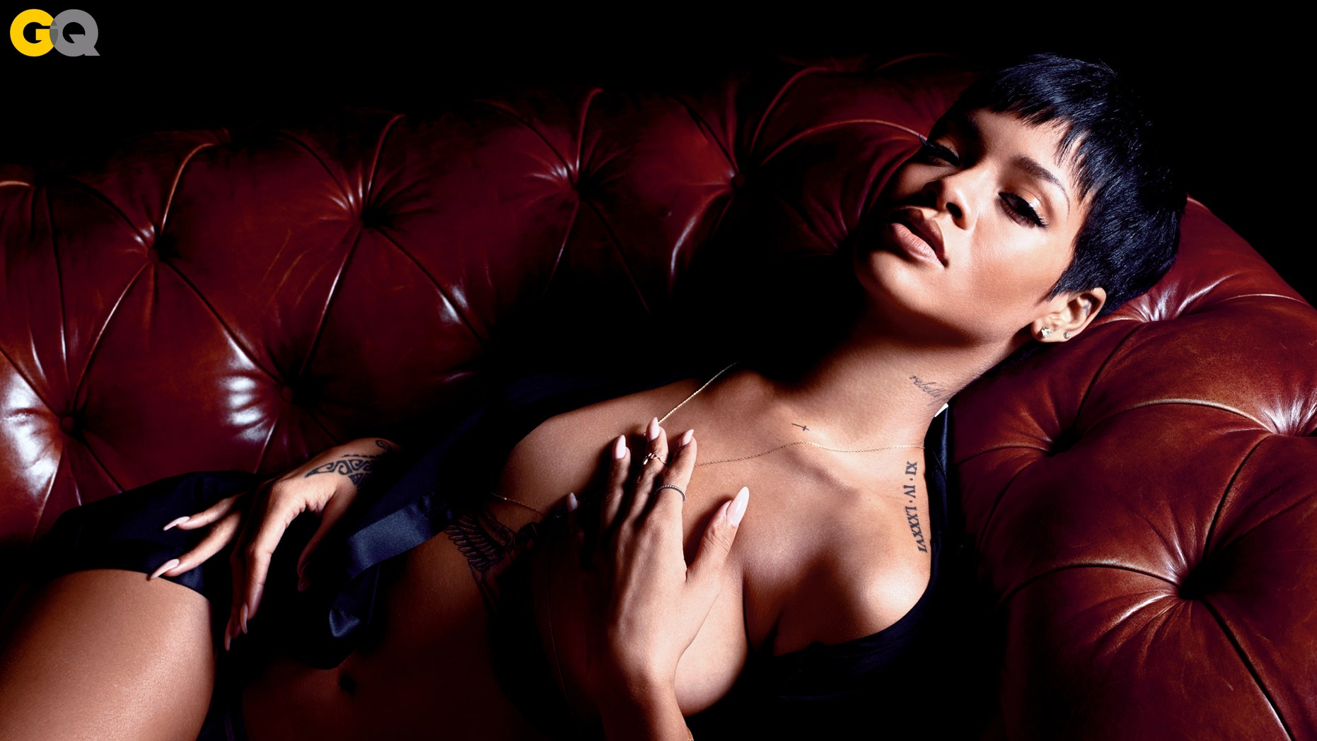 Rihanna poses for GQ's December cover.