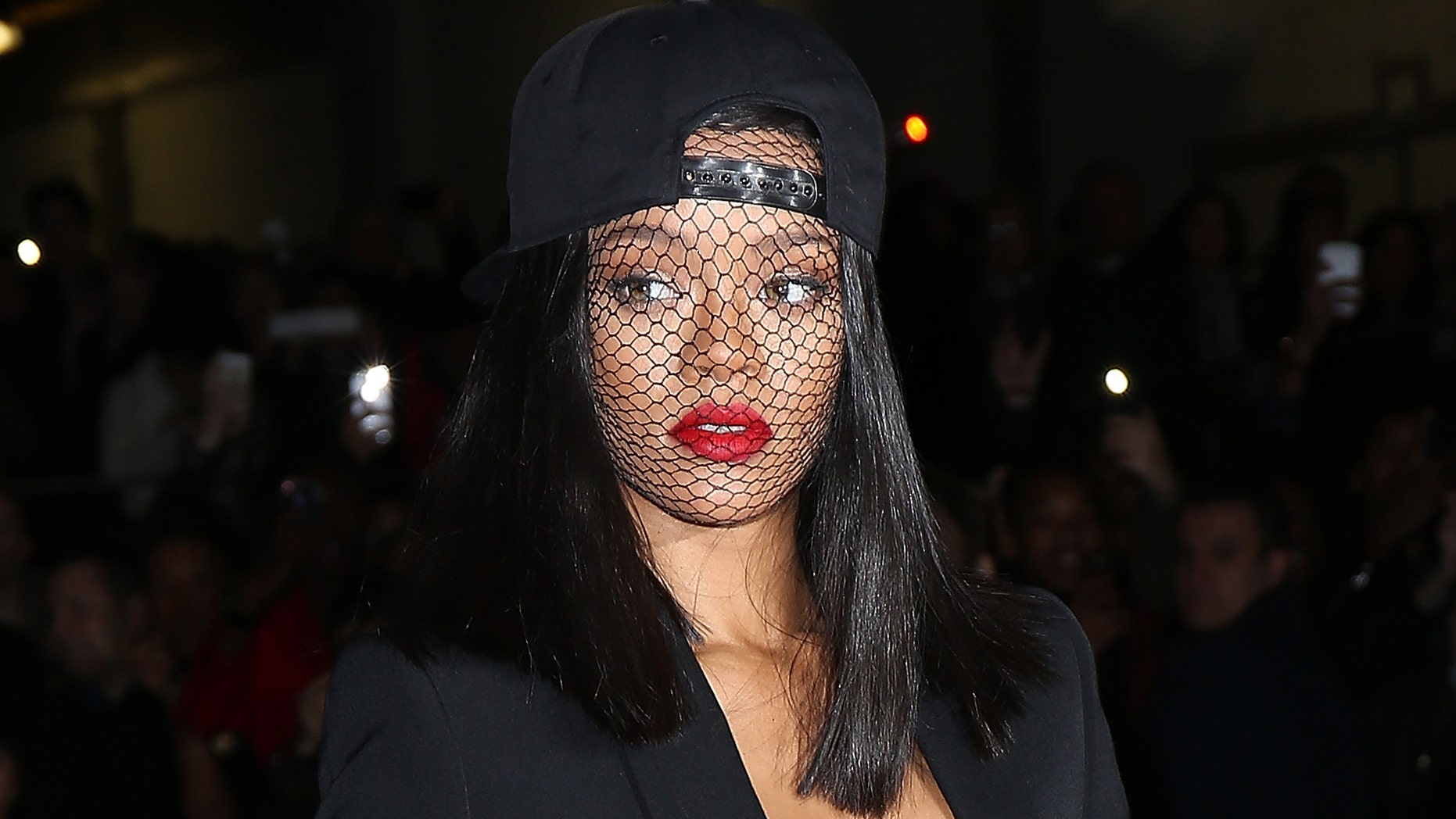 PARIS, FRANCE - MARCH 02:  Rihanna attends the Givenchy show as part of the Paris Fashion Week Womenswear Fall/Winter 2014-2015 on March 2, 2014 in Paris, France.  (Photo by Pierre Suu/Getty Images)