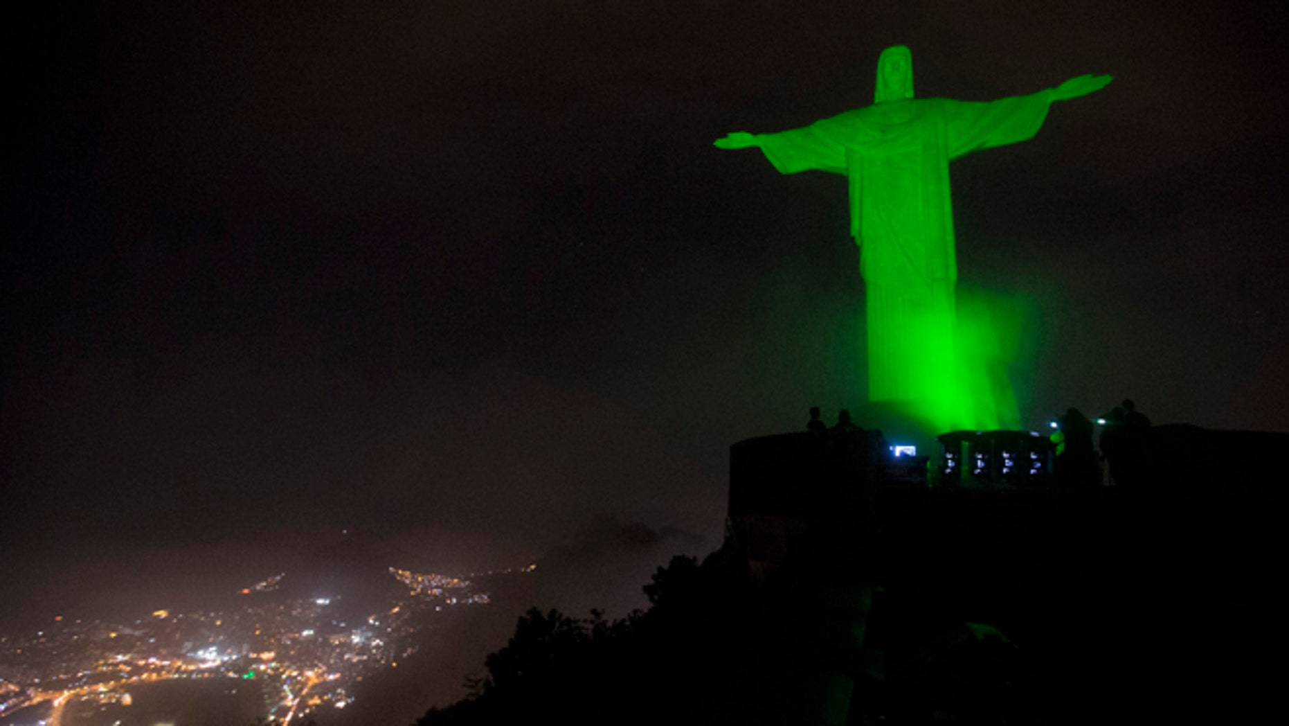 The Christ the Redeemer statue is lit up in green as a symbolic warning of the dangers of climate change, in Rio de Janeiro, Brazil, Thursday, Sept. 18, 2014. This event is in support of the Global Peoples Climate March, scheduled for the next Sunday, which is asking for solutions to combat global climate change, in advance of the United Nations Climate Summit to be held on September 23. (AP Photo/Silvia Izquierdo)