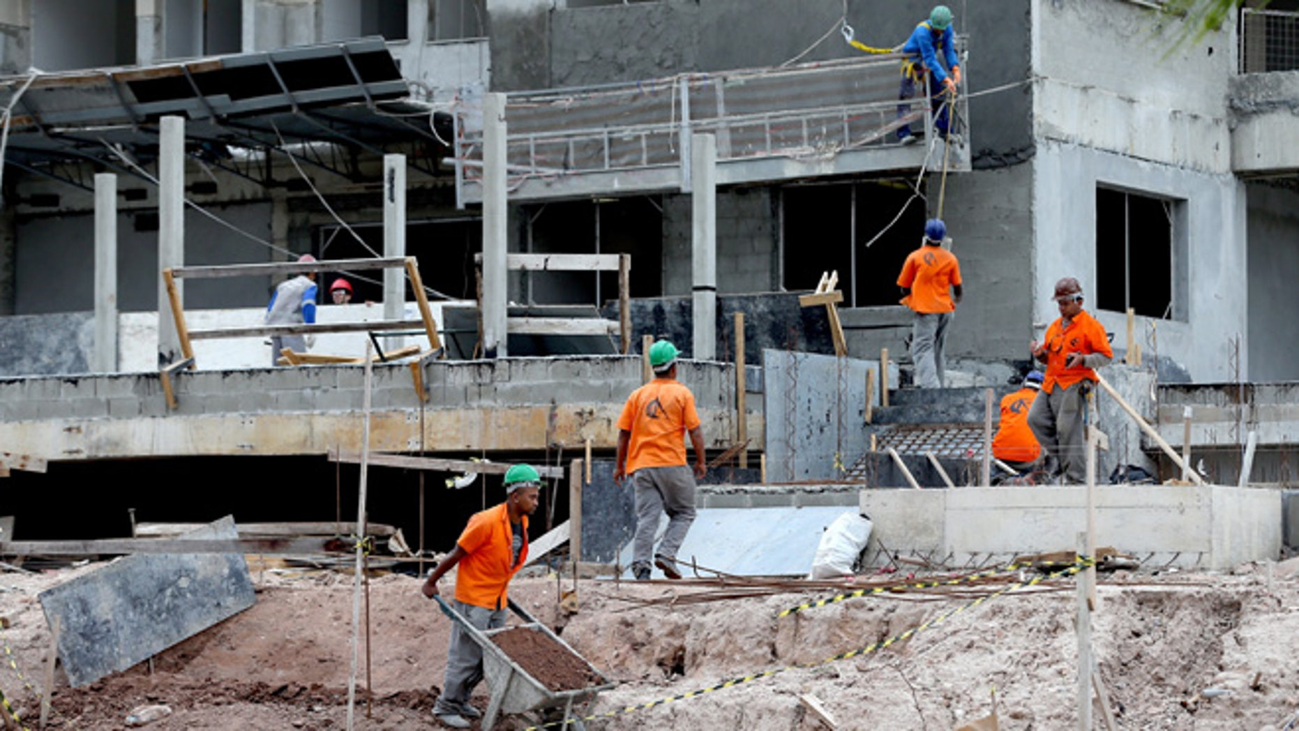 RIO DE JANEIRO, BRAZIL - JULY 21:  Construction progress takes place during a tour of the Ilha Pura housing complex, the future site of the Athletes' Village for the Rio 2016 Olympic Games, on July 21, 2015 in Rio de Janeiro, Brazil.  (Photo by Matthew Stockman/Getty Images)