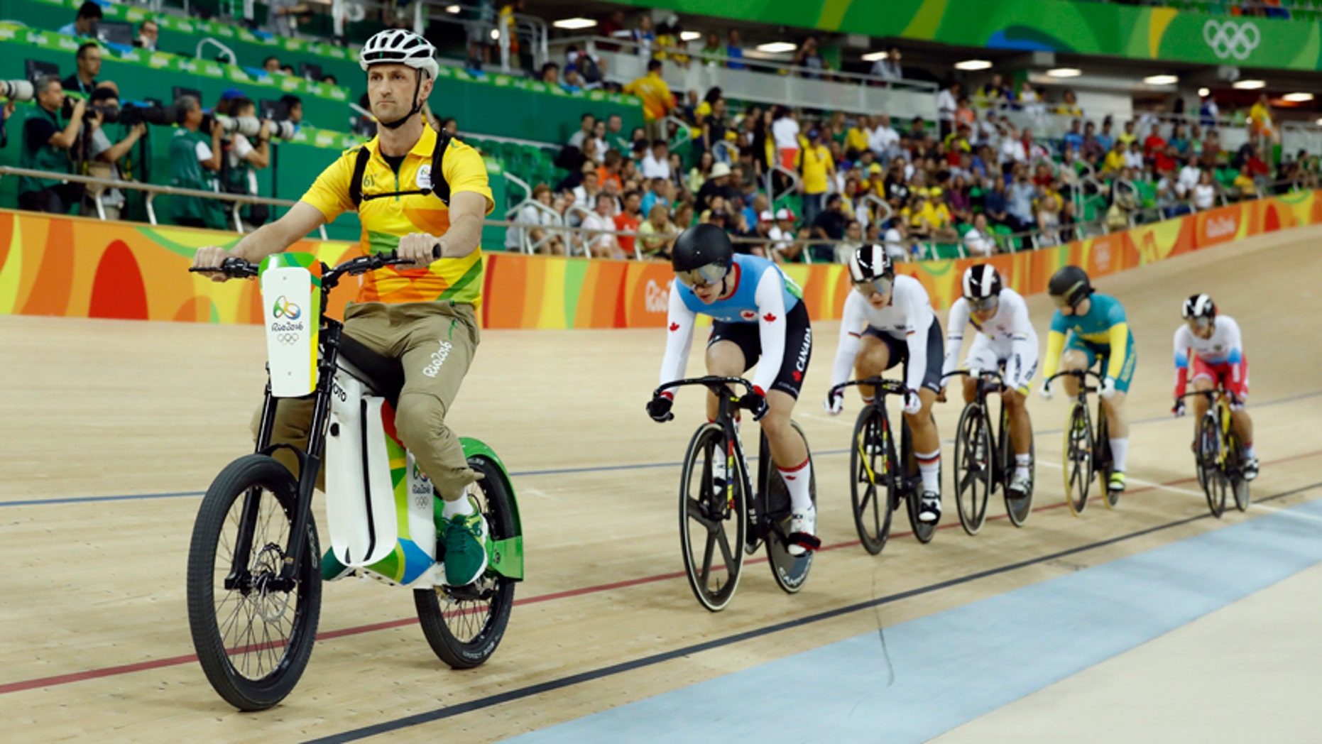 Cyclists compete in the Women's Keirin first round at the Rio Olympic Velodrome during the 2016 Summer Olympics in Rio de Janeiro, Brazil, Saturday, Aug. 13, 2016. (AP Photo/Patrick Semansky)