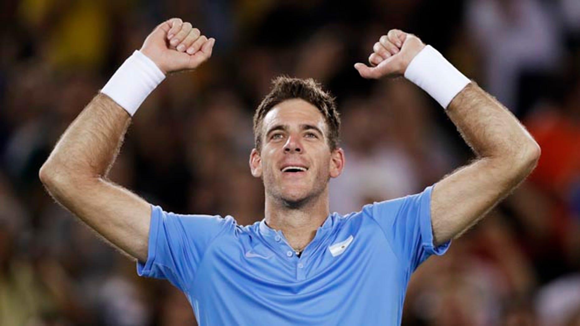 Juan Martin del Potro, of Argentina, raises his arms after defeating Novak Djokovic, of Serbia, at the 2016 Summer Olympics in Rio de Janeiro, Brazil, Sunday, Aug. 7, 2016. (AP Photo/Charles Krupa)
