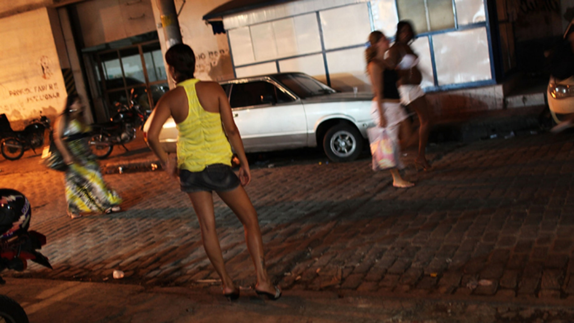 Female prostitutes walk the streets of the red light district, Vila Mimosa.   (Photo by Spencer Platt/Getty Images)