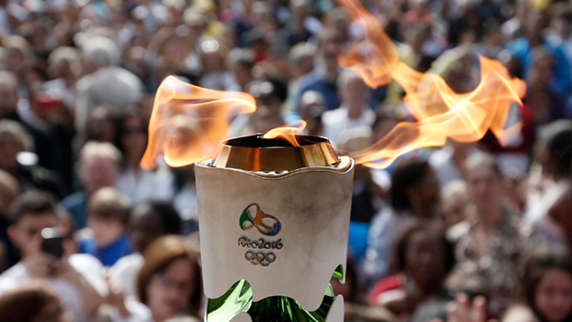 LEOPOLDINA, BRAZIL - MAY 16: Detail shot of Olympic Torch during day 14 of the Olympic Flame torch relay on May 16 , 2016 in Leopoldina, Brazil. The Olympic torch will pass through 329 cities from all states from the north to the south of Brazil, until arriving in Rio de Janeiro on August 5, to lit the cauldron.