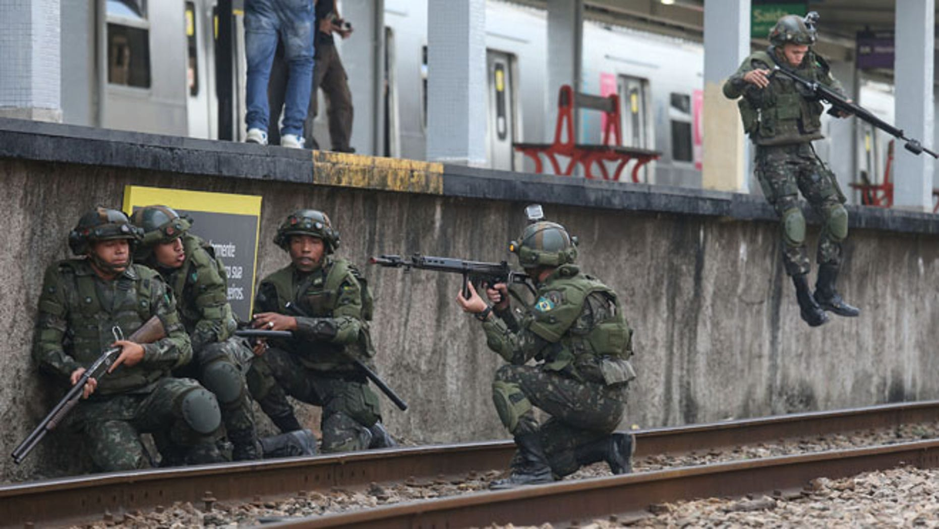 Brazilian soldiers conduct a counterterrorism drill simulating an attack at the Deodoro train station on July 16, 2016 in Rio de Janeiro, Brazil. Brazil announced yesterday it was bolstering security for the Rio 2016 Olympic Games following the truck attack in Nice, France, which killed at least 84 people. Deodoro is one of four main venue locations for the upcoming Olympics which begin August 5.  (Photo by Mario Tama/Getty Images)