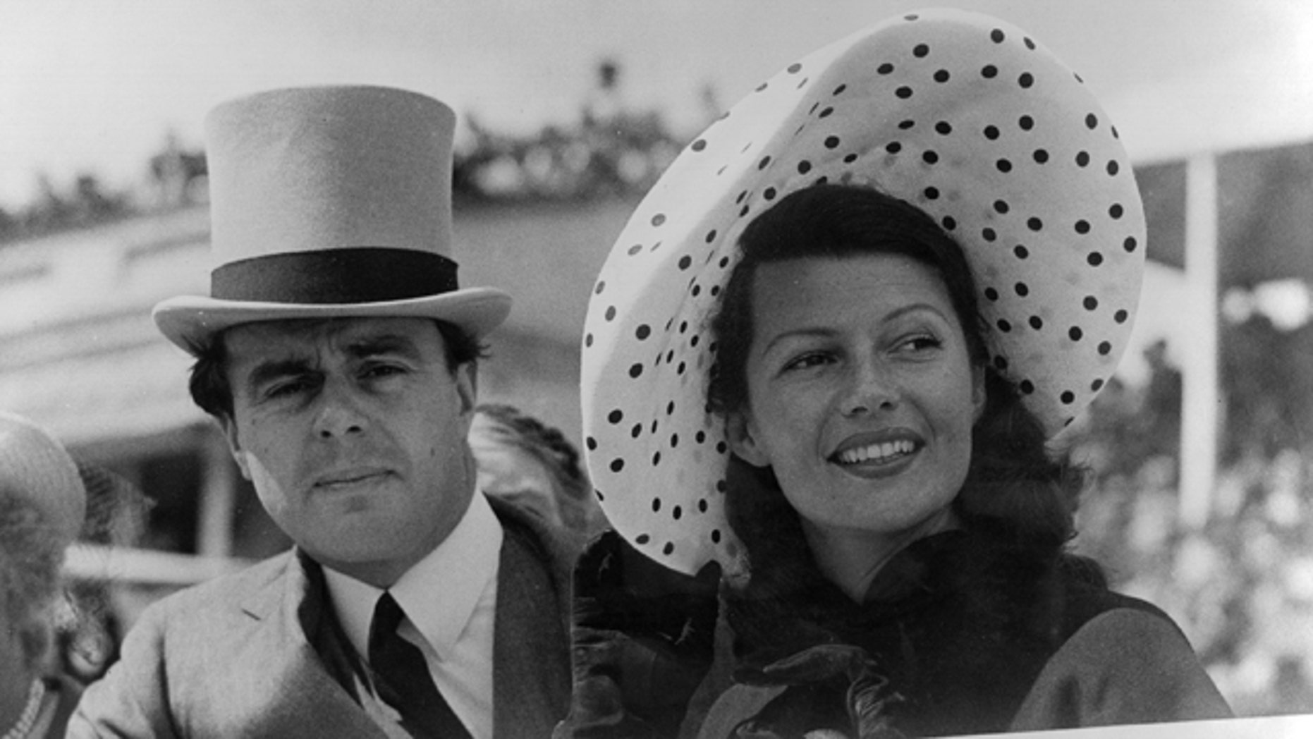 Prince Aly Khan (1911 - 1960) at Epsom races with his wife, Hollywood actress Rita Hayworth (1918 -1987).