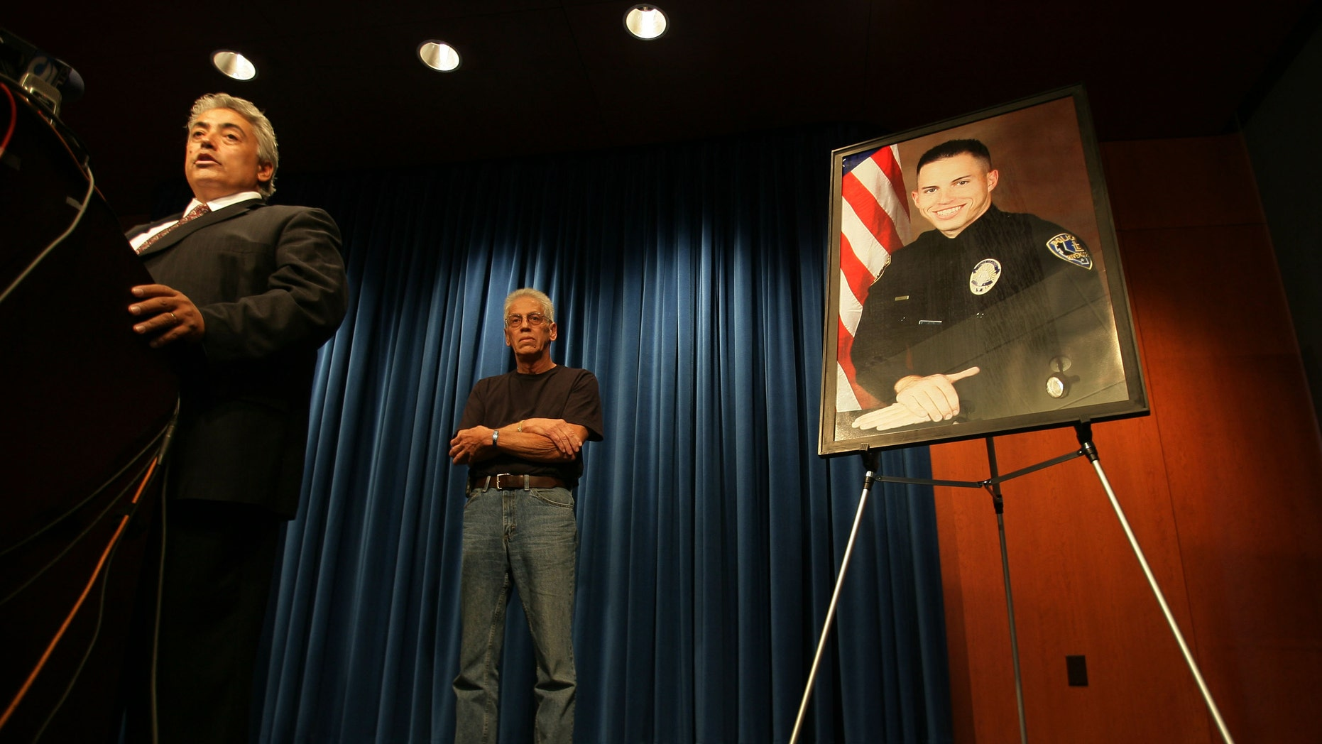 Nov. 15: Riverside County District Attorney Rod Pacheco, announces charges filed against Earl Ellis Green for the murder of Riverside Police Officer Ryan Bonaminio, pictured at right, during a news conference Riverside, Calif.