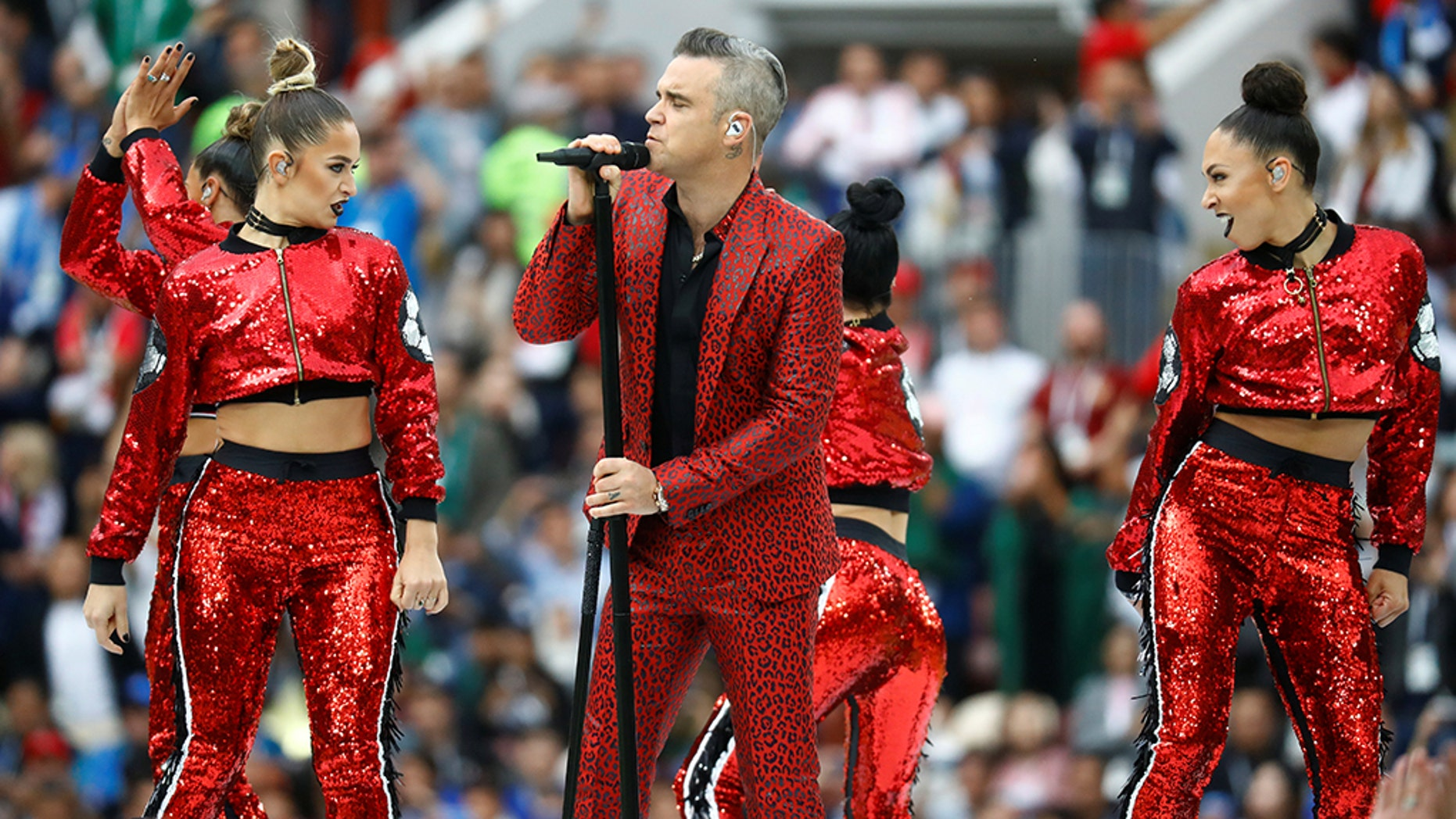 Robbie Williams performs during the opening ceremony of the World Cup.