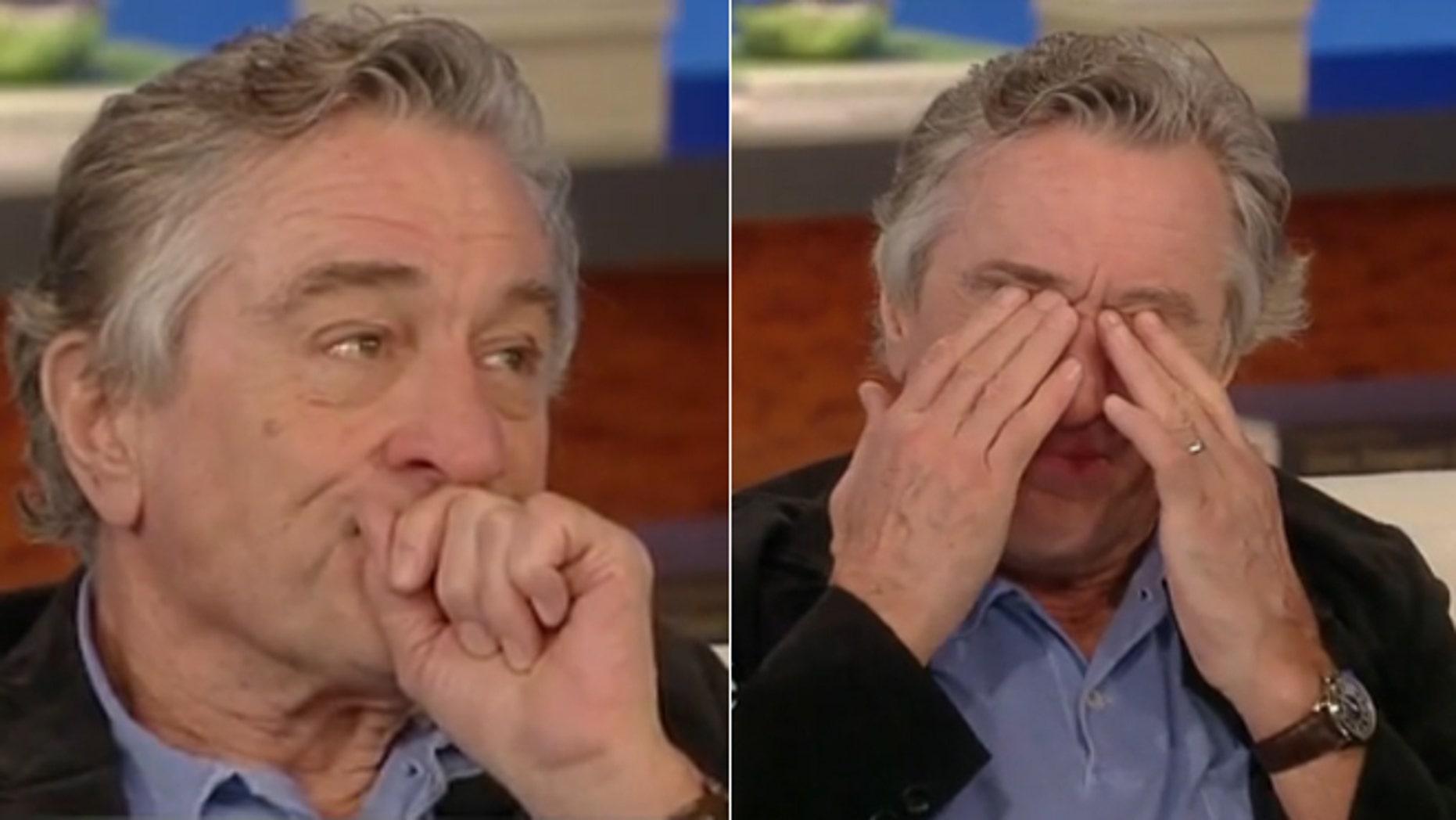 Robert De Niro tears up during an interview with Katie Couric.