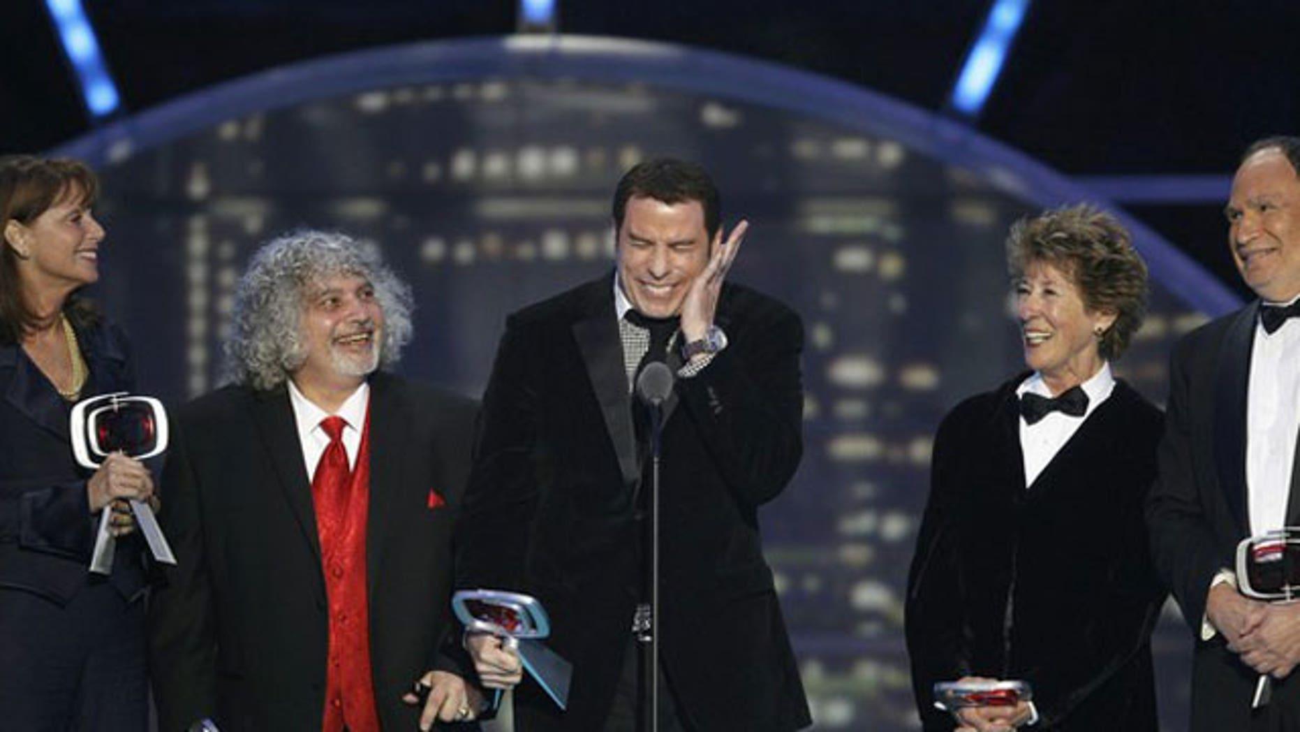 "April 10, 2011: Actors (L-R) Marcia Strassman, Robert Hegyes, John Travolta, Ellen Travolta and Gabe Kaplan accept the ""35th Anniversary"" award during the 2011 TV Land Awards."