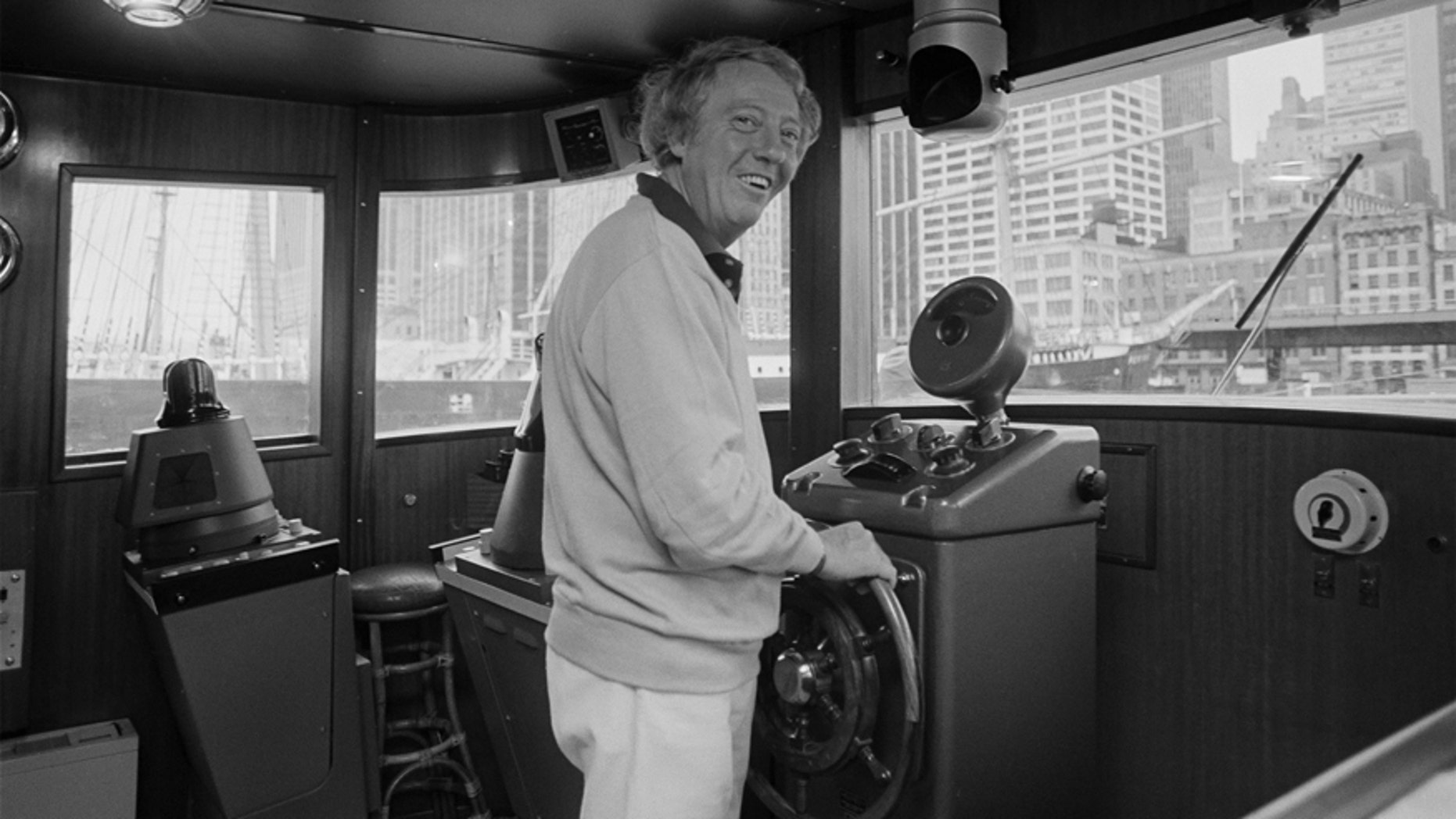 A Sept. 30, 1979 photo from files of pop impresario Robert Stigwood aboard his yacht Sarina as he readies to sail out of the South Street Seaport in lower Manhattan.