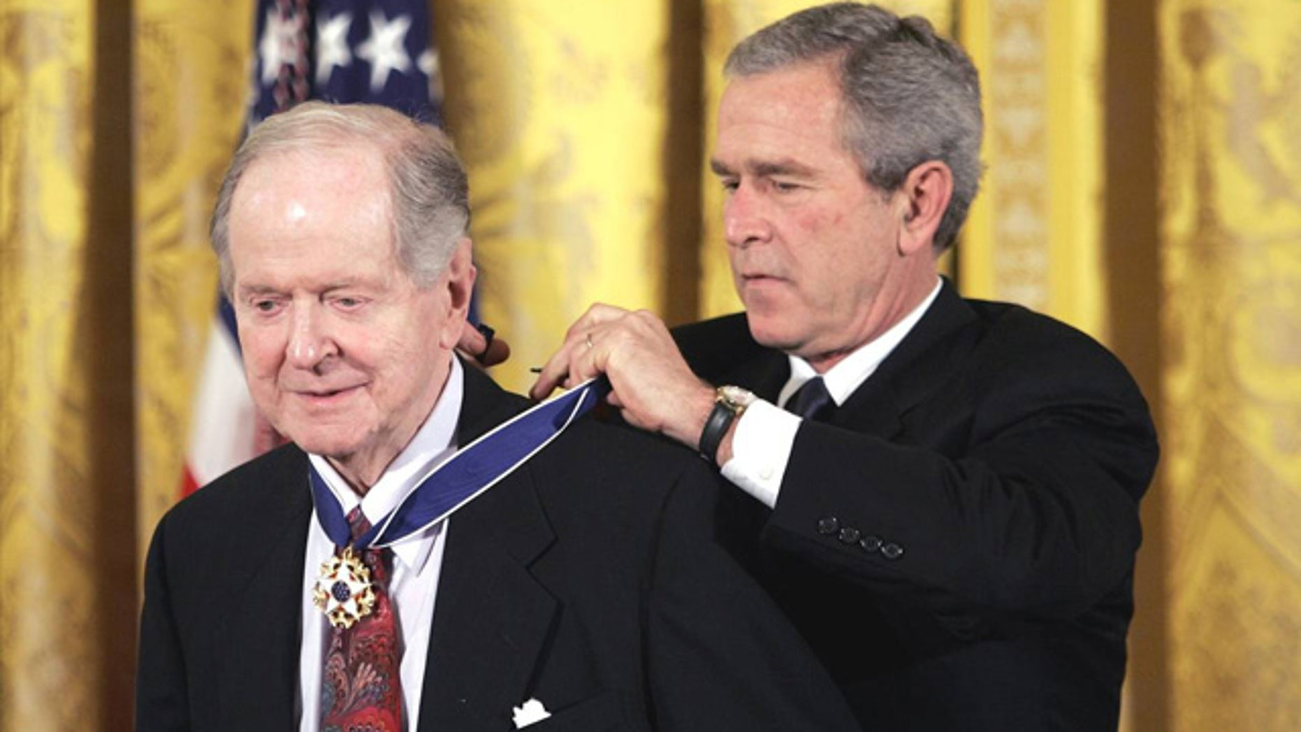 Nov. 9, 2005: Historian Robert Conquest receives the Presidential Medal of Freedom from President George W. Bush at the White House (Evan Vucci/AP)