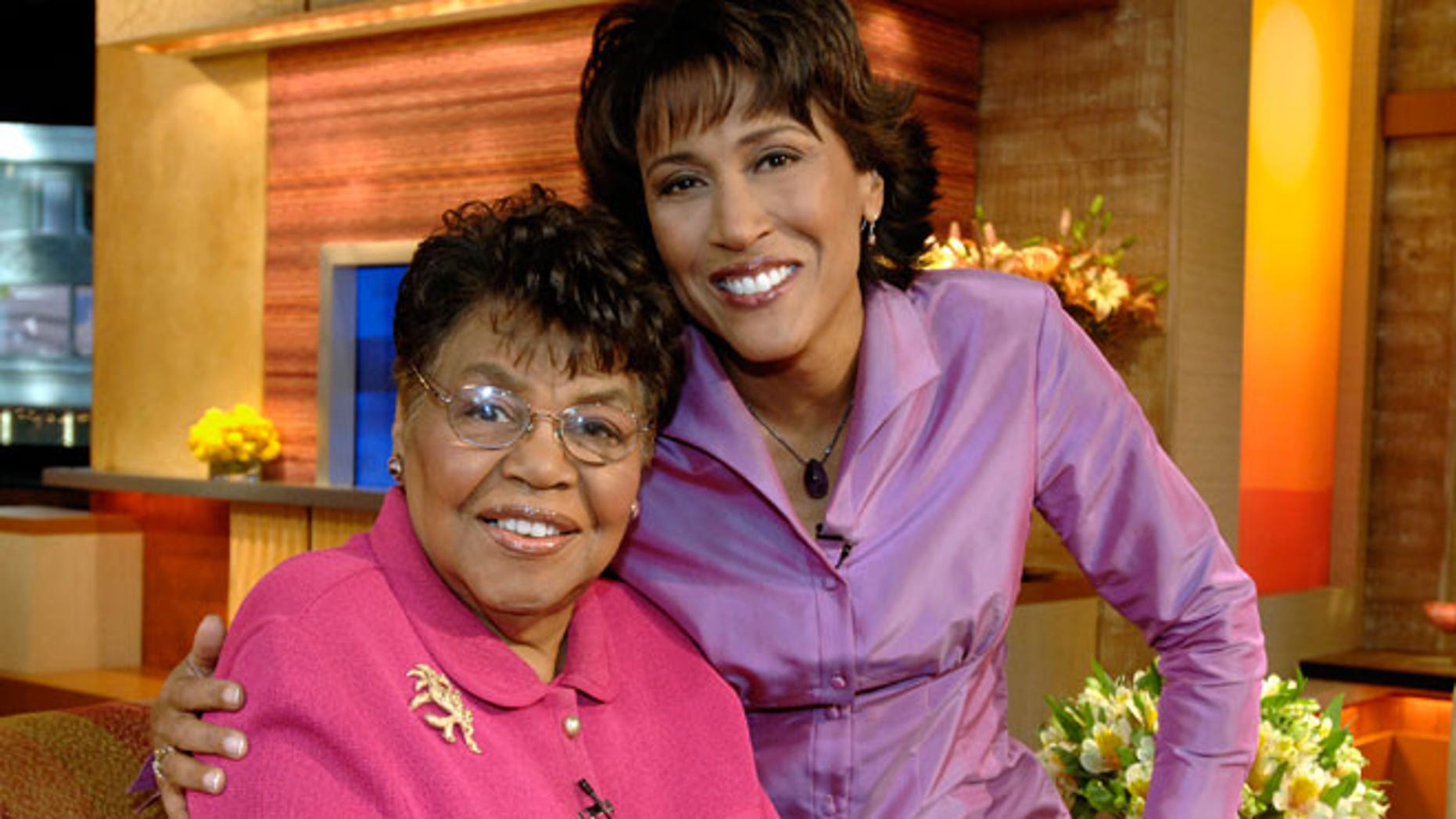 "This 2006 photo released by ABC shows ""Good Morning America"" co-host Robin Roberts, right, with her mother, the late Lucimarian Roberts on the set in New York."