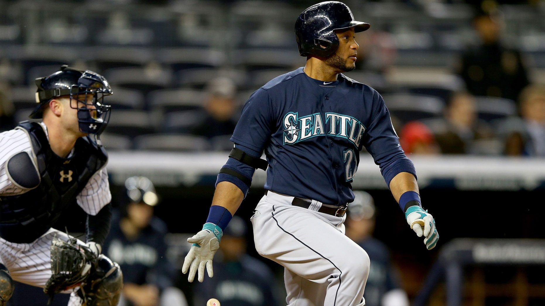 NEW YORK, NY - APRIL 29:  Robinson Cano #22 of the Seattle Mariners takes a swing in the seventh inning as Brian McCann #34 of the New York Yankees defends on April 29, 2014 at Yankee Stadium in the Bronx borough of New York City.  (Photo by Elsa/Getty Images)