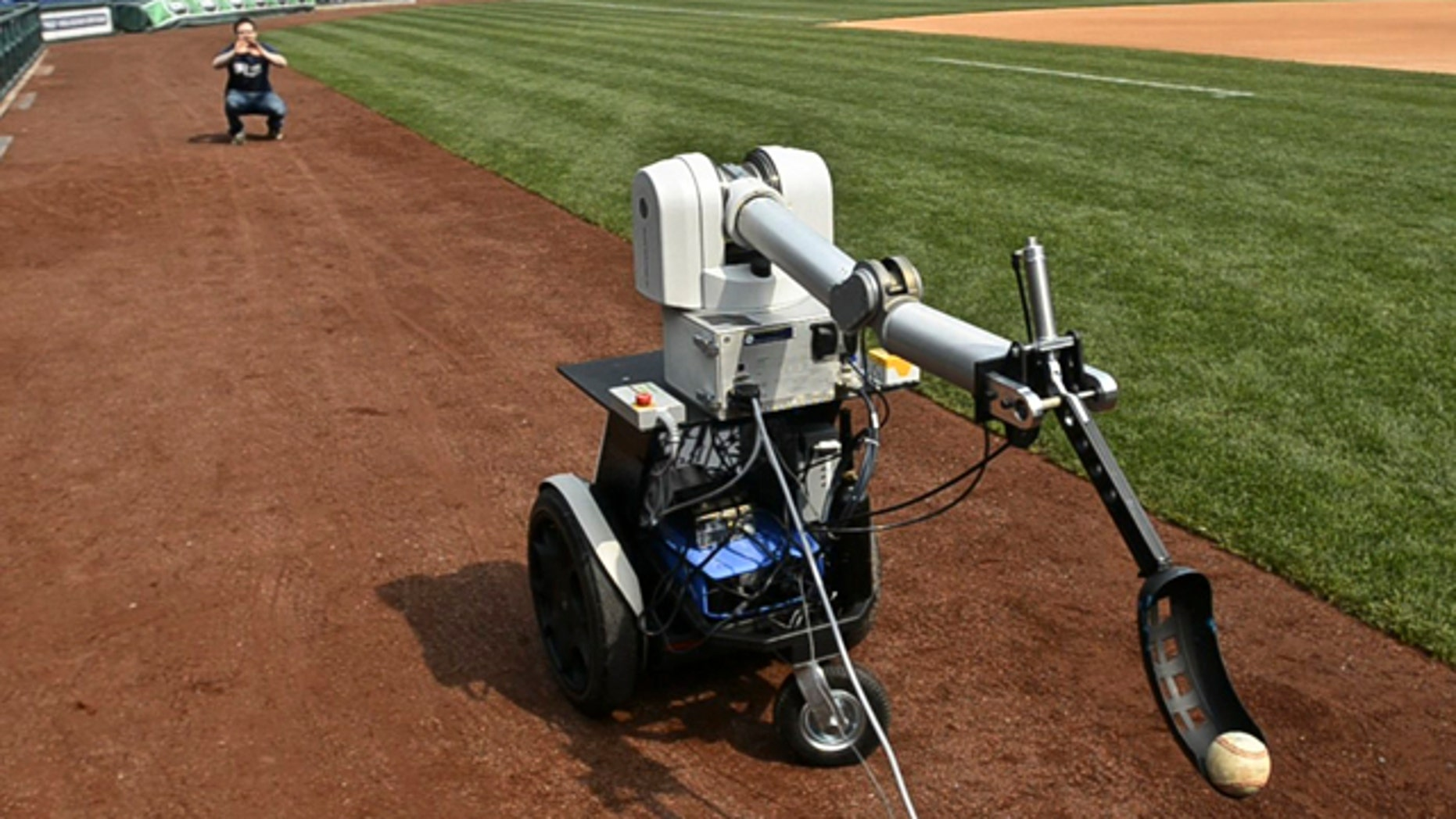 Jamie Gewirtz waits for a robot to throw him a ball at Citizens Bank Park in Philadelphia, Monday April 18, 2011.