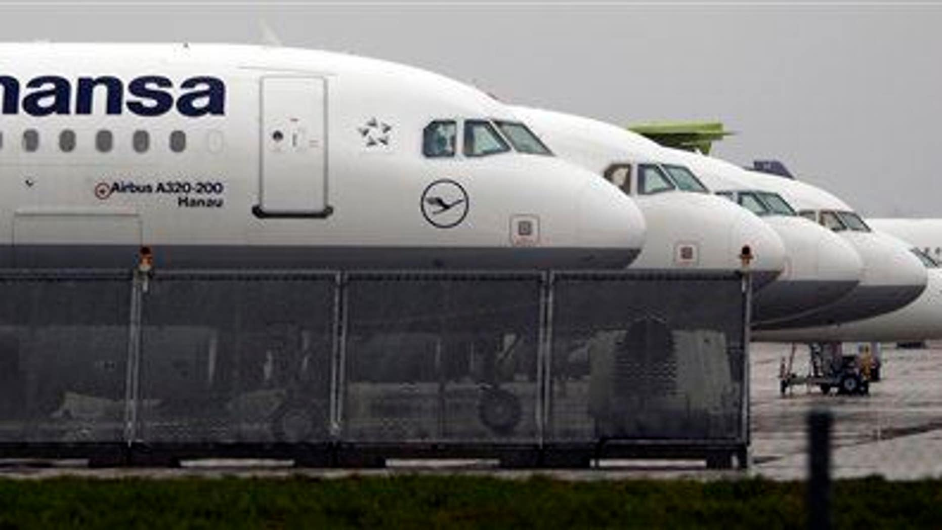 Lufthansa planes are parked at the airport at the airport in Munich, southern Germany.