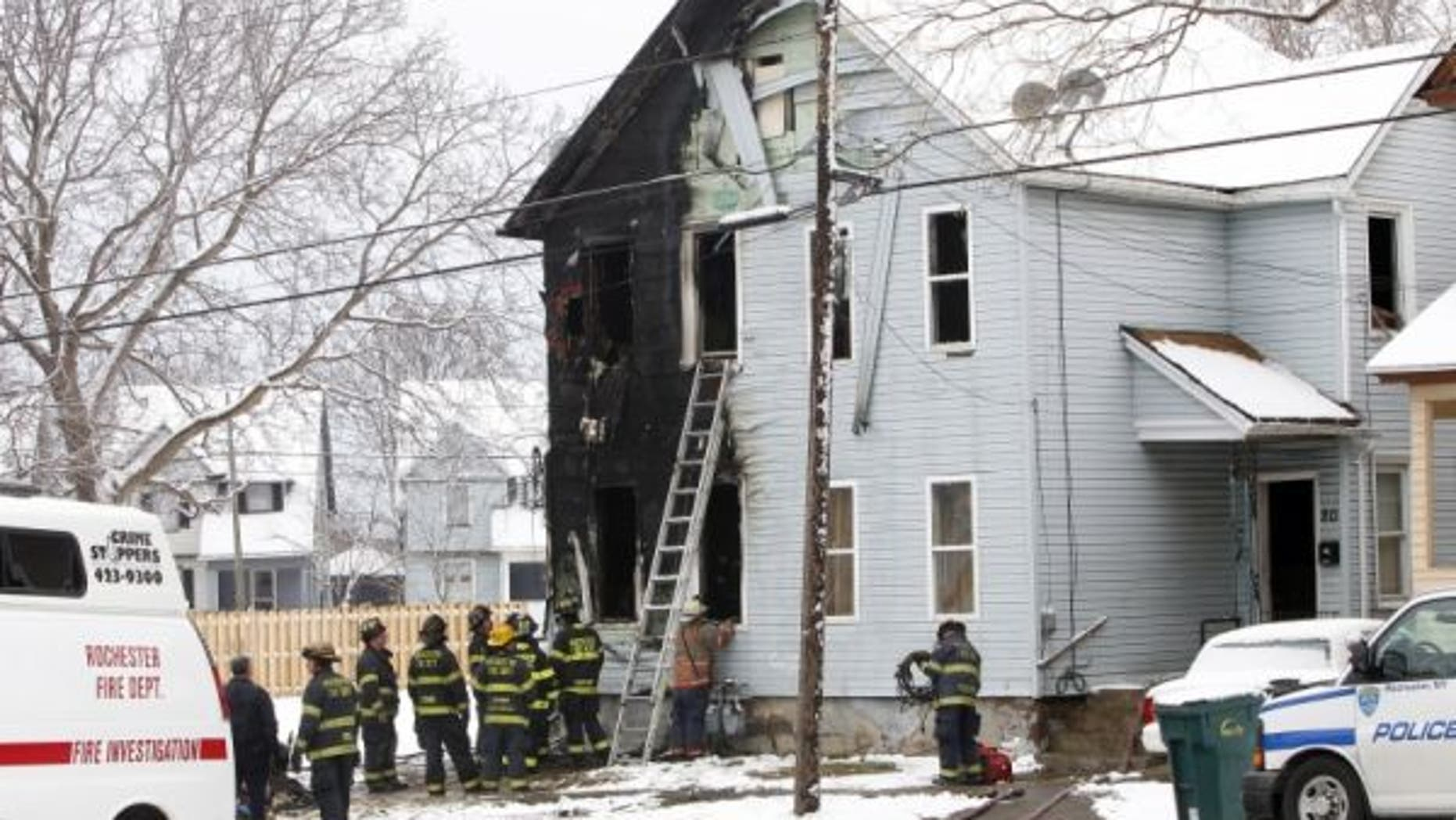 February 18, 2012: Rochester Fire Department officials work at the scene of a fire in Rochester, N.Y.