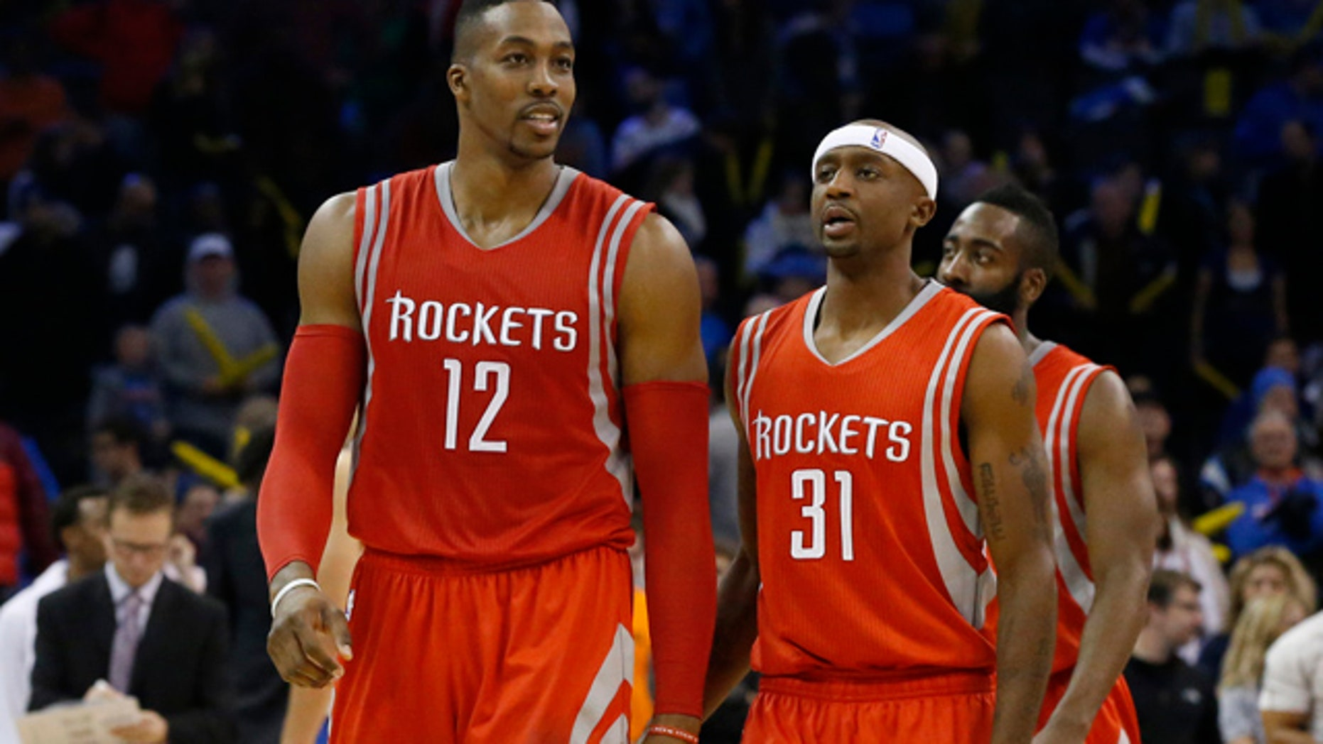 November 16, 2014: Houston Rockets' Dwight Howard (12), smiles as he, Jason Terry (31) and James Harden, right, walk off the court during a time out in the fourth quarter of an NBA basketball game in Oklahoma City. Houston won 69-65. (AP Photo/Sue Ogrocki)