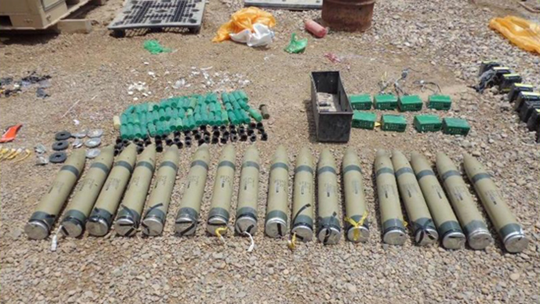 A failed Improvised Rocket-Assisted Missile attack on a U.S. military outpost in eastern Iraq led an explosives team to this nearby weapons cache in July. Analysis indicates that the 107mm rockets are unique to Iranian design and manufacturing, validating U.S. assertions that the Iranian Regime has been playing an increasingly nefarious role within Iraq's borders.