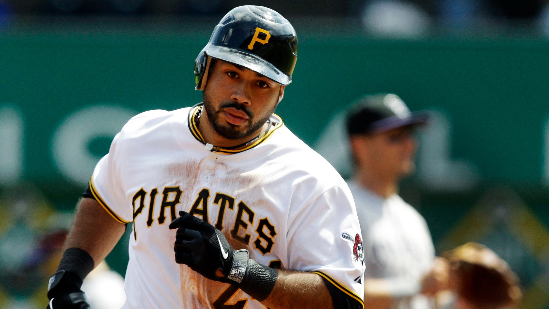 Pittsburgh Pirates' Pedro Alvarez rounds third after hitting a solo-home run off Colorado Rockies pitcher Juan Nicasio in the seventh inning of a baseball game in Pittsburgh, Wednesday, April 25, 2012. The Rockies won the first game of a double header 2-1. (AP Photo/Gene J. Puskar)