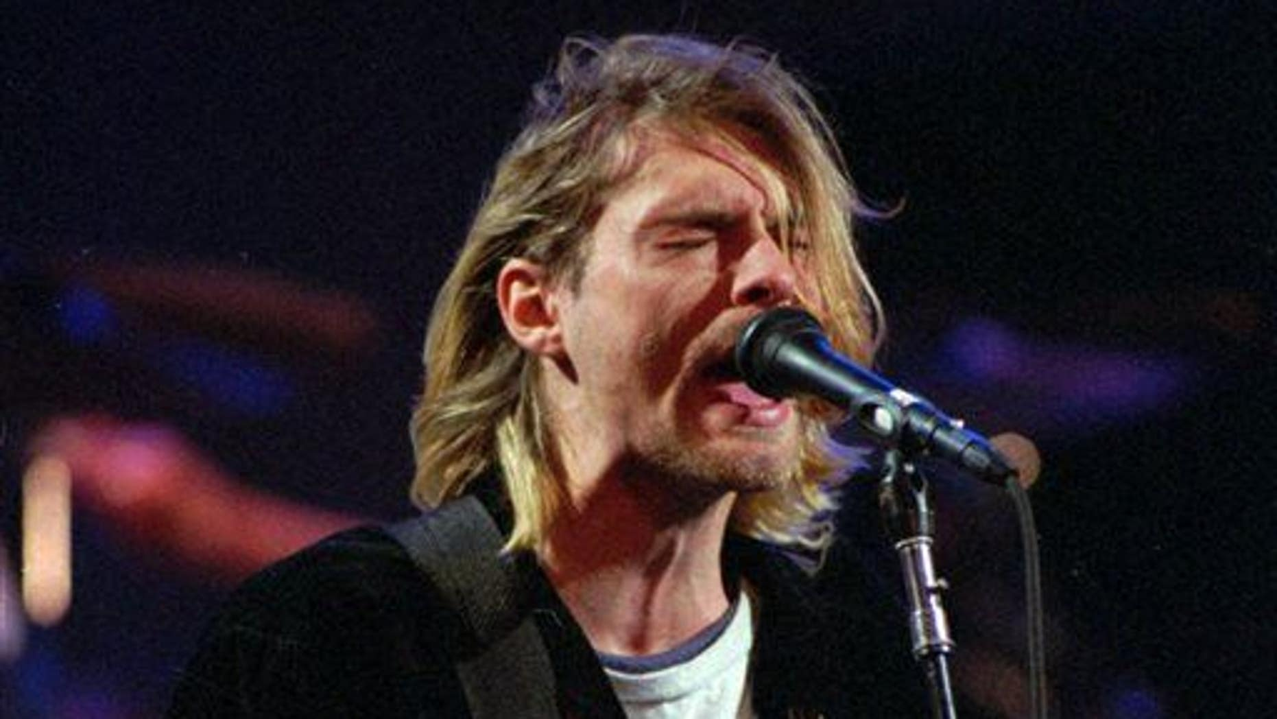 This Dec. 13, 1993 file photo shows Kurt Cobain of the Seattle band Nirvana performing in Seattle, Wash.