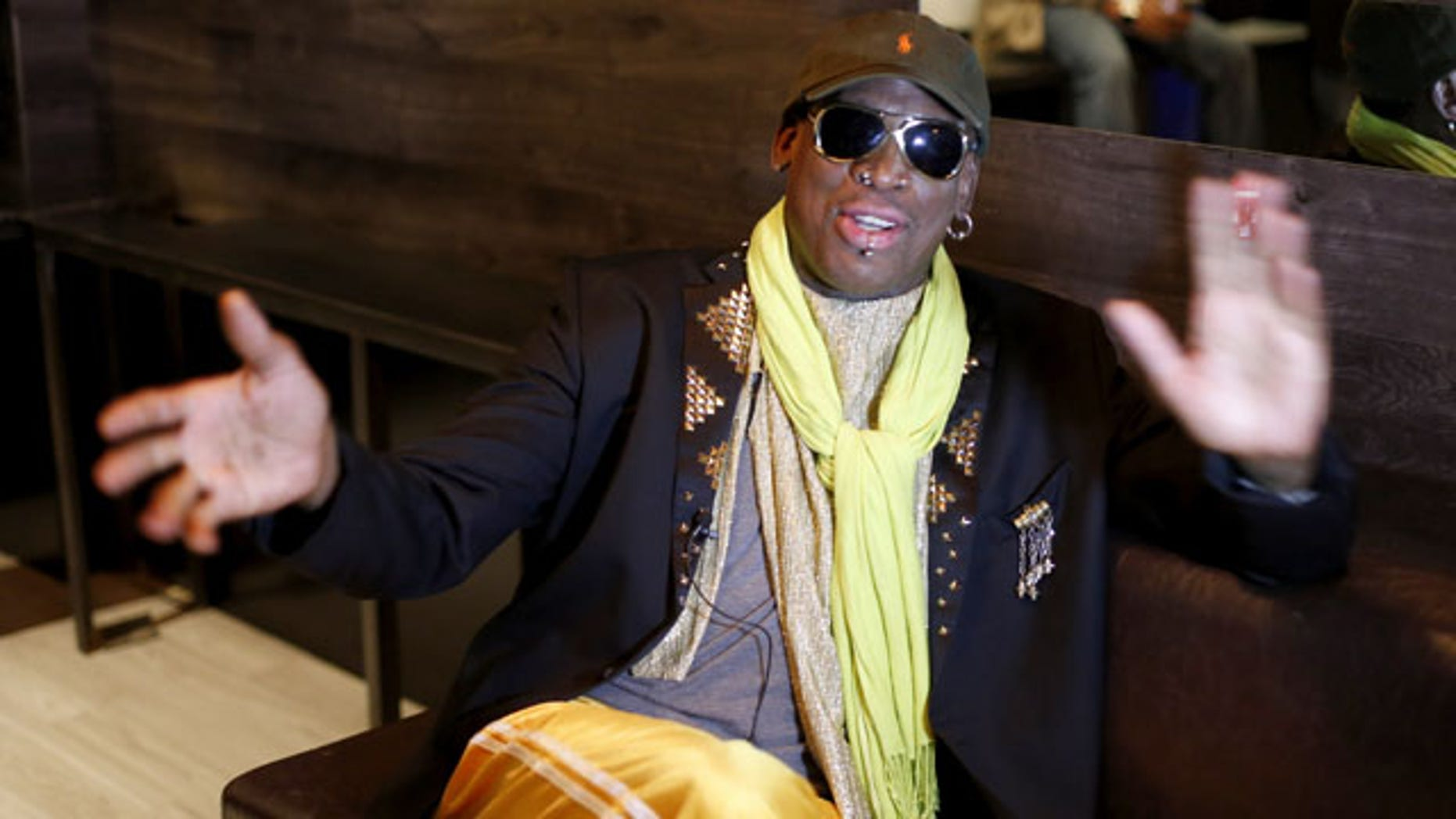 November 21, 2013: Dennis Rodman gestures during an interview after a promotional event to pitch a vodka brand in Chicago. (AP Photo)