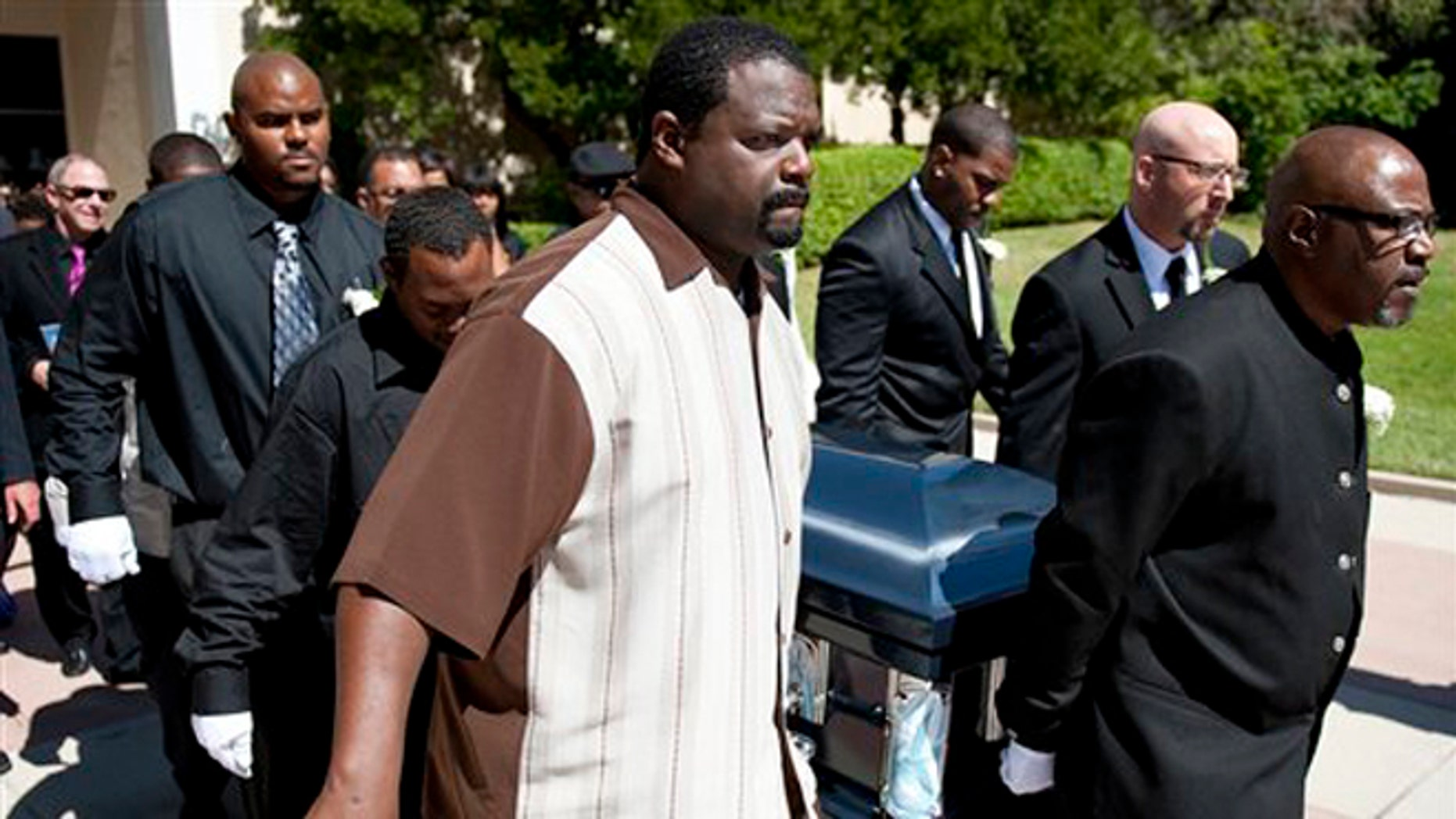 June 30, 2012: Rodney King's casket is carried out of the Hall of Liberty at Forest Lawn-Hollywood Hills, in Los Angeles after a memorial service.