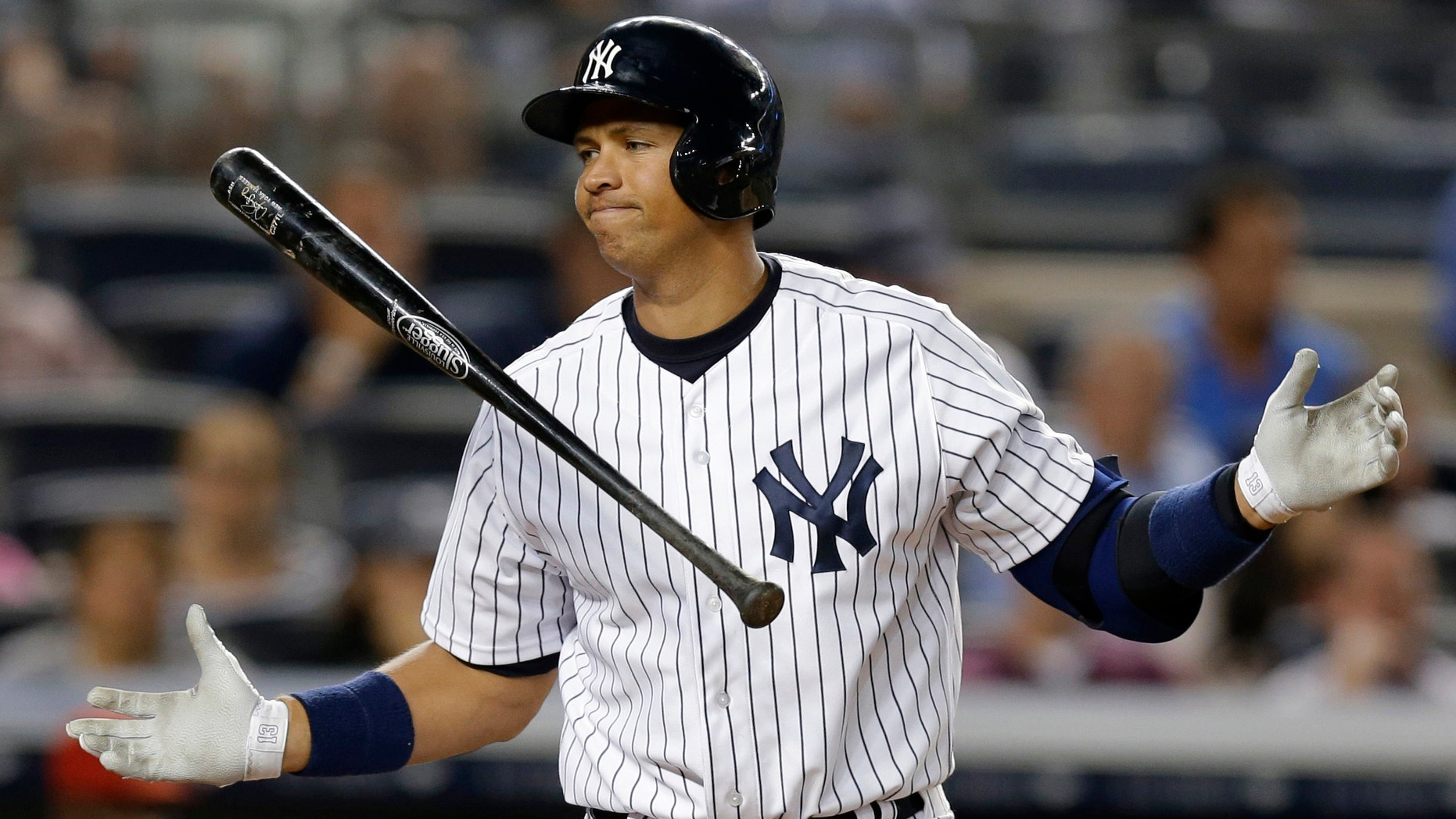 FILE - In this Aug. 13, 2013 file photo, New York Yankees' Alex Rodriguez reacts after striking out in the seventh inning of a baseball game against the Los Angeles Angels in New York.  Rodriguezâs drug suspension has been reduced to 162 games, potentially sidelining the slugger for the entire 2014 season.  The New York Yankees third baseman was suspended for 211 games on Aug. 5 by baseball Commissioner Bud Selig. The penalty was given for alleged violations of the sport's drug agreement and labor contract and followed Major League Baseball's investigation of the Biogenesis of America anti-aging clinic, which was accused of distributing banned performance-enhancing drugs.  (AP Photo/Kathy Willens, File)