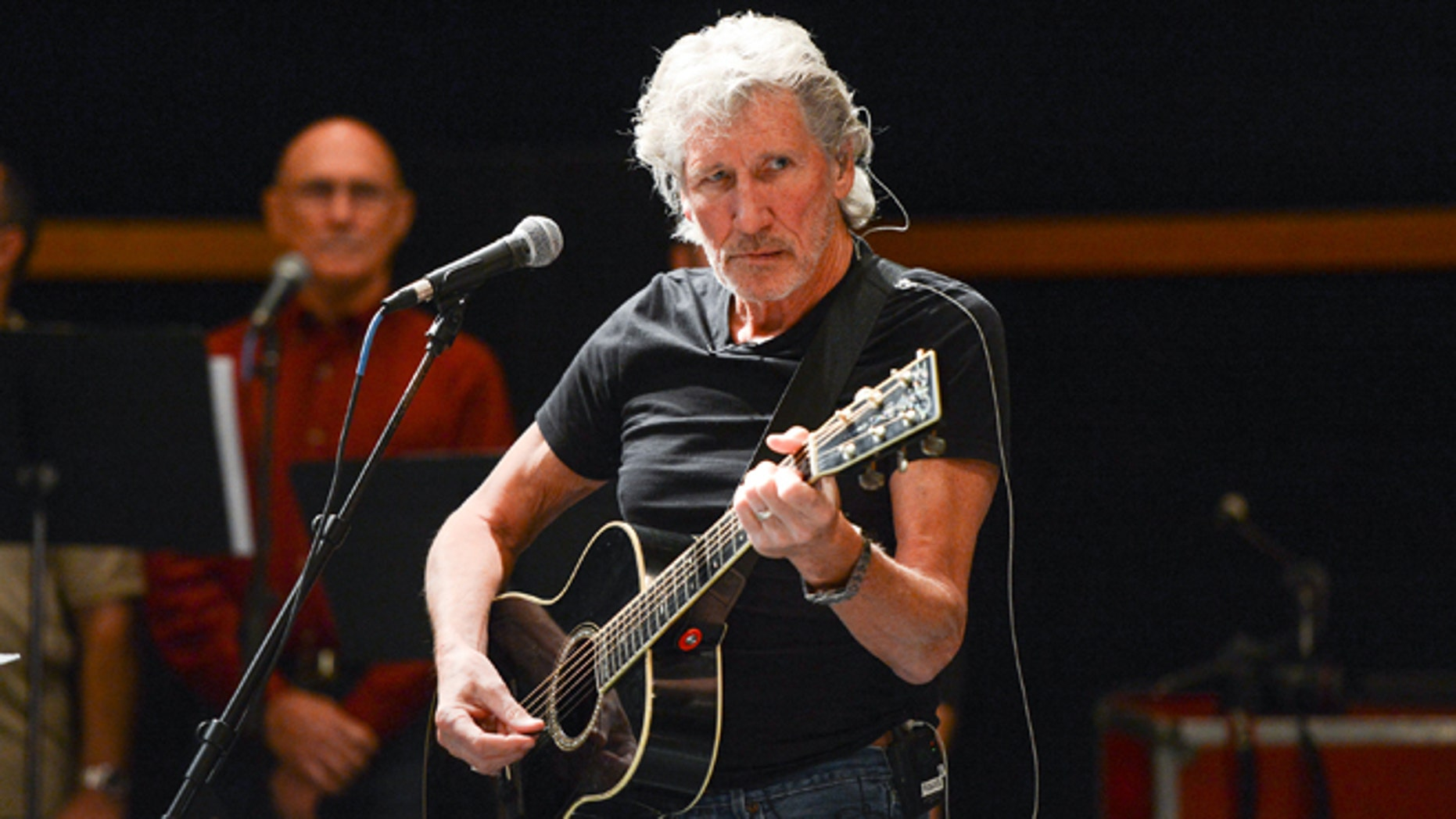 """FILE - In this Nov. 4, 2013 file photo, musician Roger Waters and his band hold rehearsals with members of the Wounded Warriors Project, in New York. In the first of three concerts this week in Mexico City, on Wednesday, Sept. 28, 2016, Waters blasted Donald Trump and called on Mexicos President Enrique Peña Nieto to """"listen to your people"""" and to answer for the thousands of missing persons in the country since the beginning of his mandate. (Photo by Evan Agostini/Invision/AP, File)"""
