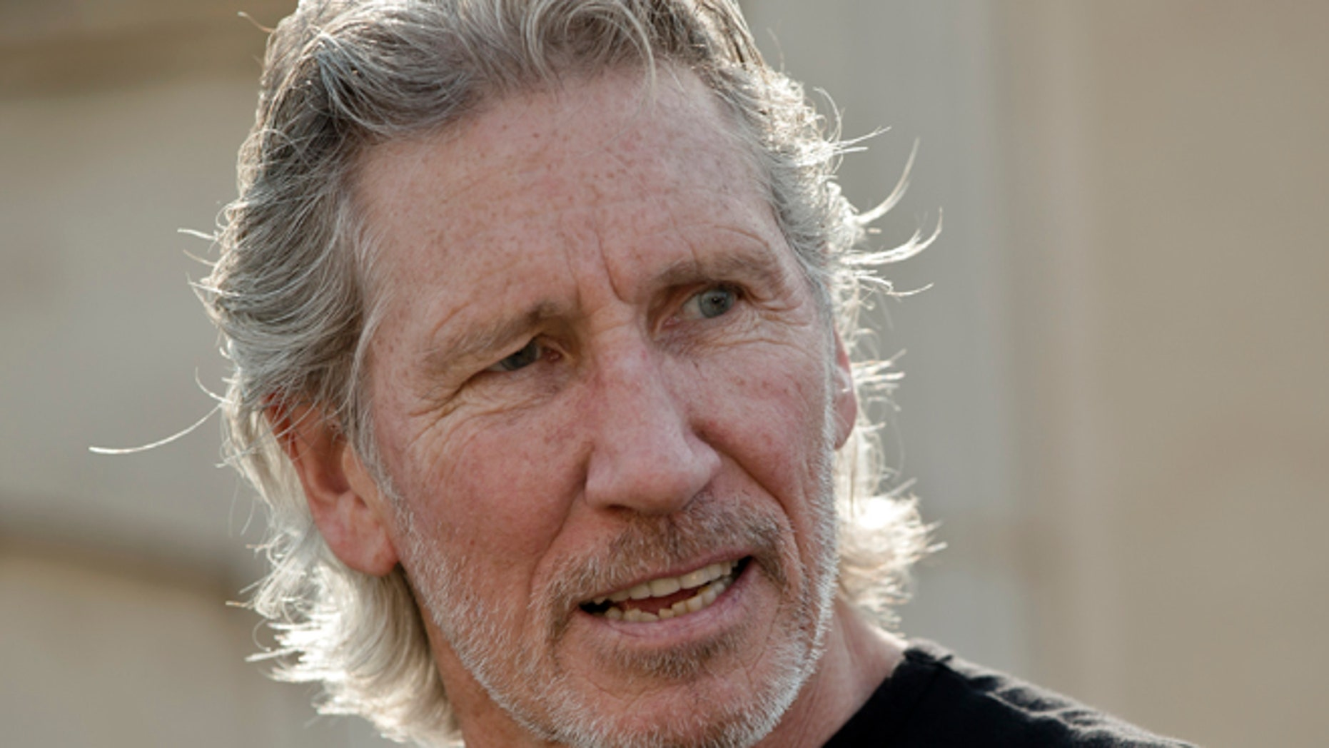 Aug. 28, 2013: Roger Waters, co-founder of the British rock band Pink Floyd reacts during a photo call before his The Wall Live show in Bucharest, Romania.