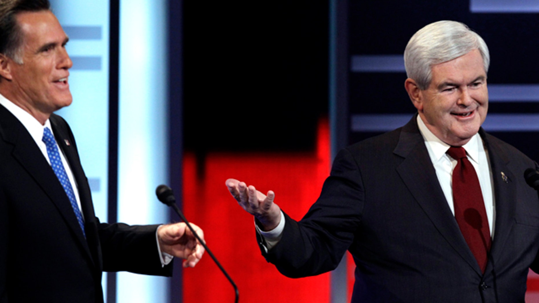 Dec. 10: Mitt Romney, left, and Newt Gingrich, square off in GOP debate.