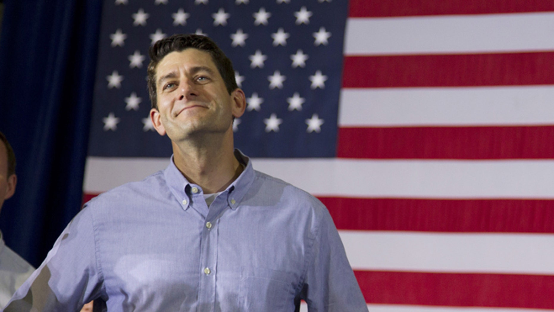 June 18, 2012: Rep. Paul Ryan, R-Wis., looks on during a campaign event with Republican presidential candidate, former Massachusetts Gov. Mitt Romney at Monterey Mills  in Janesville, Wis.