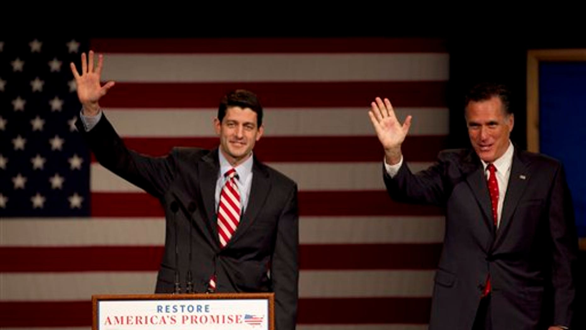 March 30: U.S. Rep. Paul Ryan, R-Wis., Chairman of the House Budget Committee, left, and GOP presidential candidate, former Massachusetts Gov. Mitt Romney wave to the audience as Romney takes the stage during a campaign stop on the campus of Lawrence University, in Appleton, Wis.