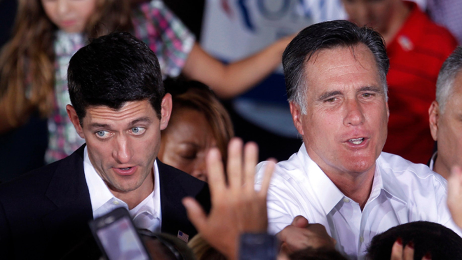 Aug. 11, 2012: Republican presidential candidate, former Massachusetts Gov. Mitt Romney, right, and his newly announced vice presidential running mate, Rep. Paul Ryan, R-Wis., left, greet supporters during a campaign rally in Manassas, Va.