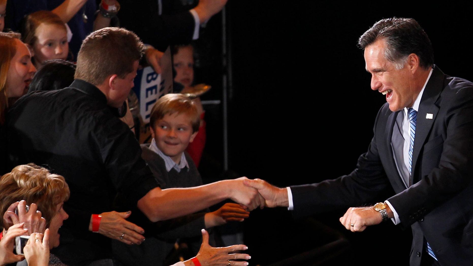 Republican presidential candidate former Massachusetts Gov. Mitt Romney greets supporters at his Nevada caucus night victory celebration in Las Vegas, Saturday, Feb. 4, 2012. (AP Photo/Gerald Herbert)
