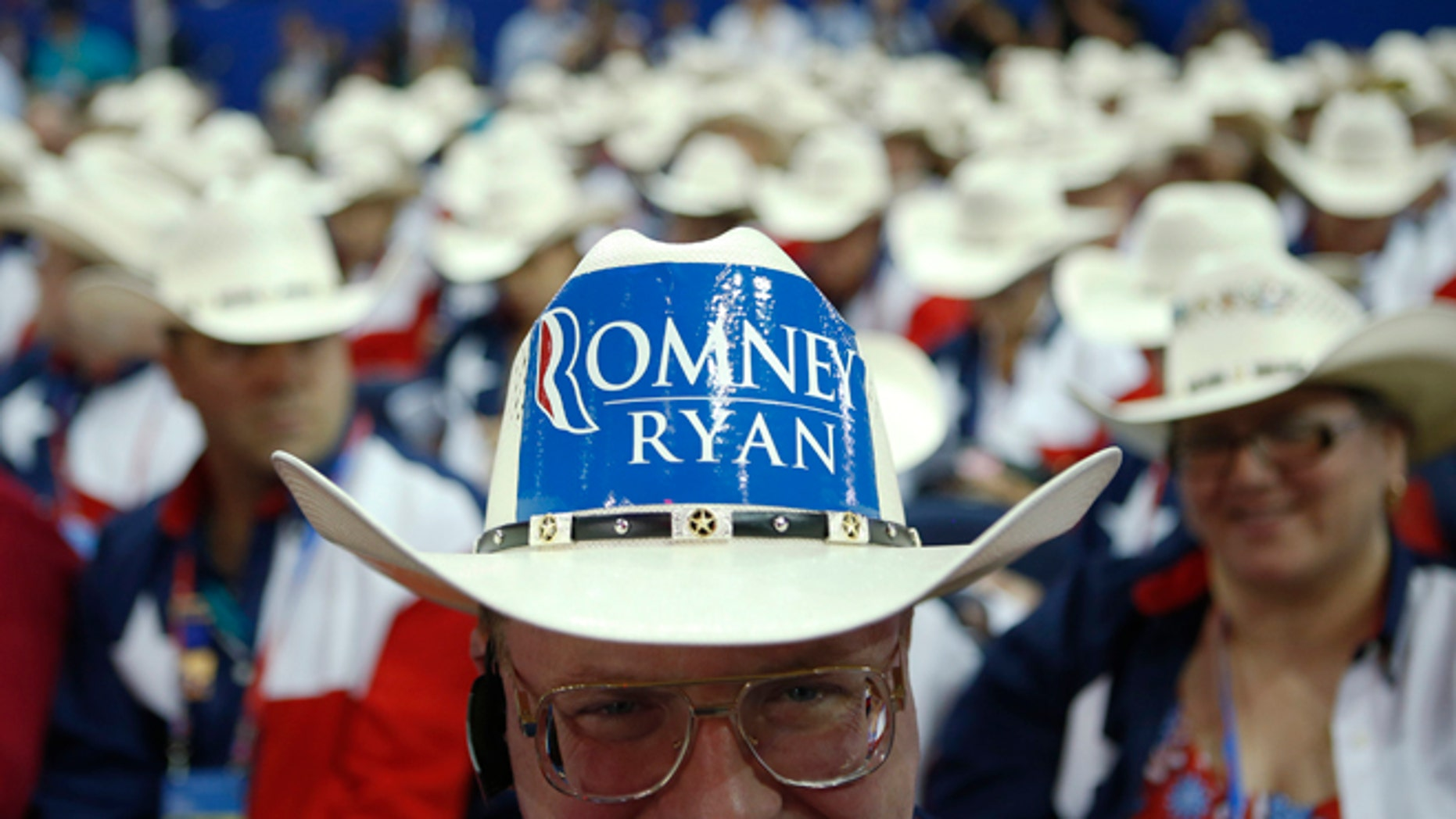 Texas delegate Clint Moore and the rest of Texas delegates fashion their cowboy hats at the Republican National Convention in Tampa, Fla., on Tuesday, Aug. 28, 2012. (AP Photo/Jae C. Hong)