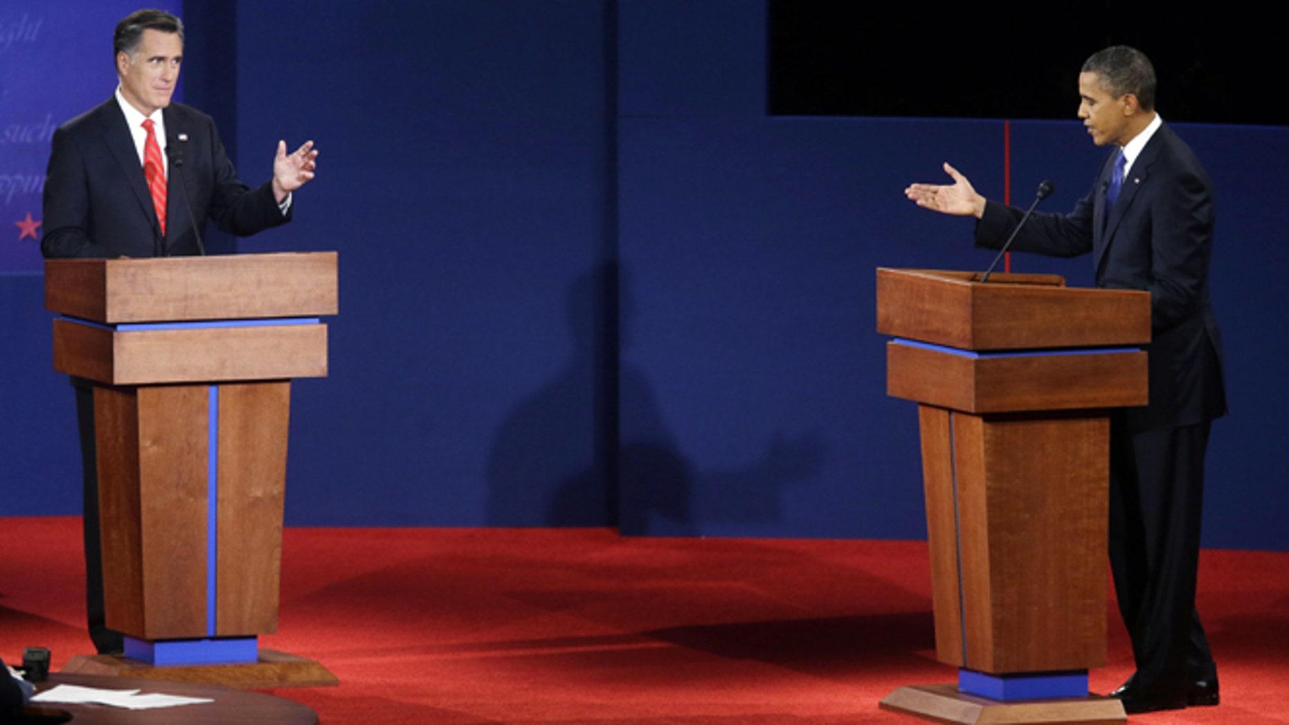 Republican presidential candidate, former Massachusetts Gov. Mitt Romney, left, and President Barack Obama, right, debate at the University of Denver, Wednesday, Oct. 3, 2012, in Denver. (AP Photo/Pablo Martinez Monsivais)