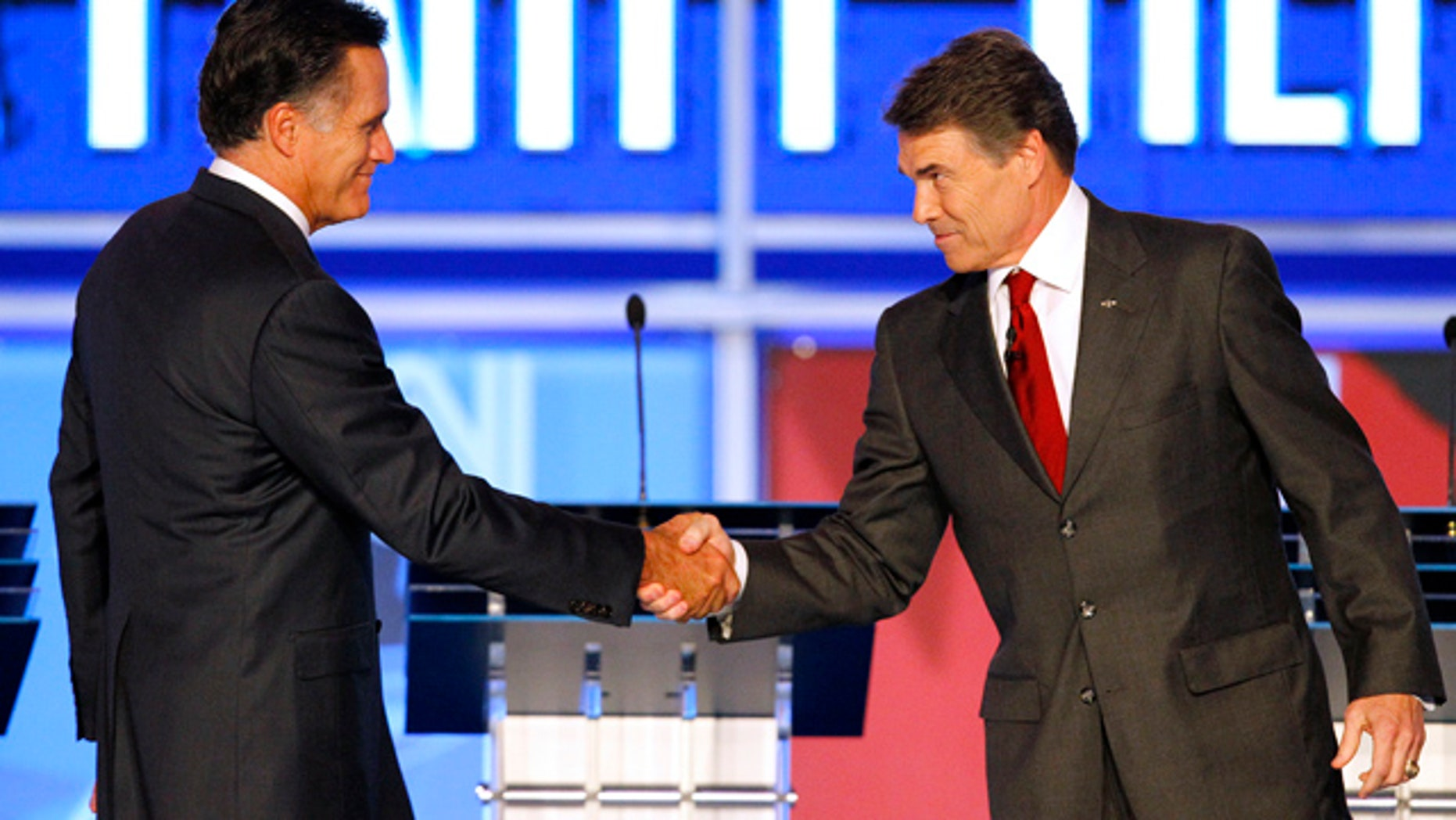 Sept. 12: Republican presidential candidates former Massachusetts Gov. Mitt Romney shakes hands with Texas Gov. Rick Perry before the start of a Republican debate in Tampa, Fla.