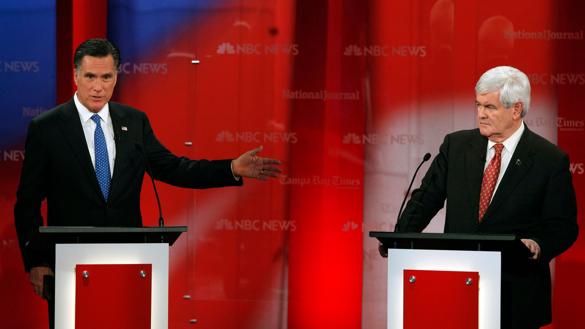Republican presidential candidate, former Massachusetts Gov. Mitt Romney, gestures to former House Speaker Newt Gingrich during a Republican presidential debate Monday, Jan. 23, 2012, at the University of South Florida in Tampa, Fla. (AP Photo/Paul Sancya)