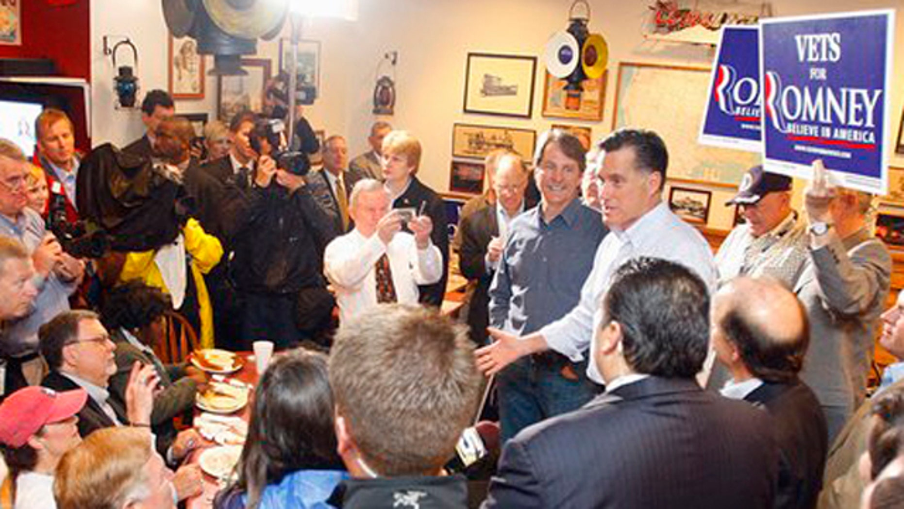 Mar. 12, 2012: Republican presidential candidate, former Massachusetts Gov. Mitt Romney greets supporters who braved the rain during a campaign stop at the Whistle Stop Cafe.