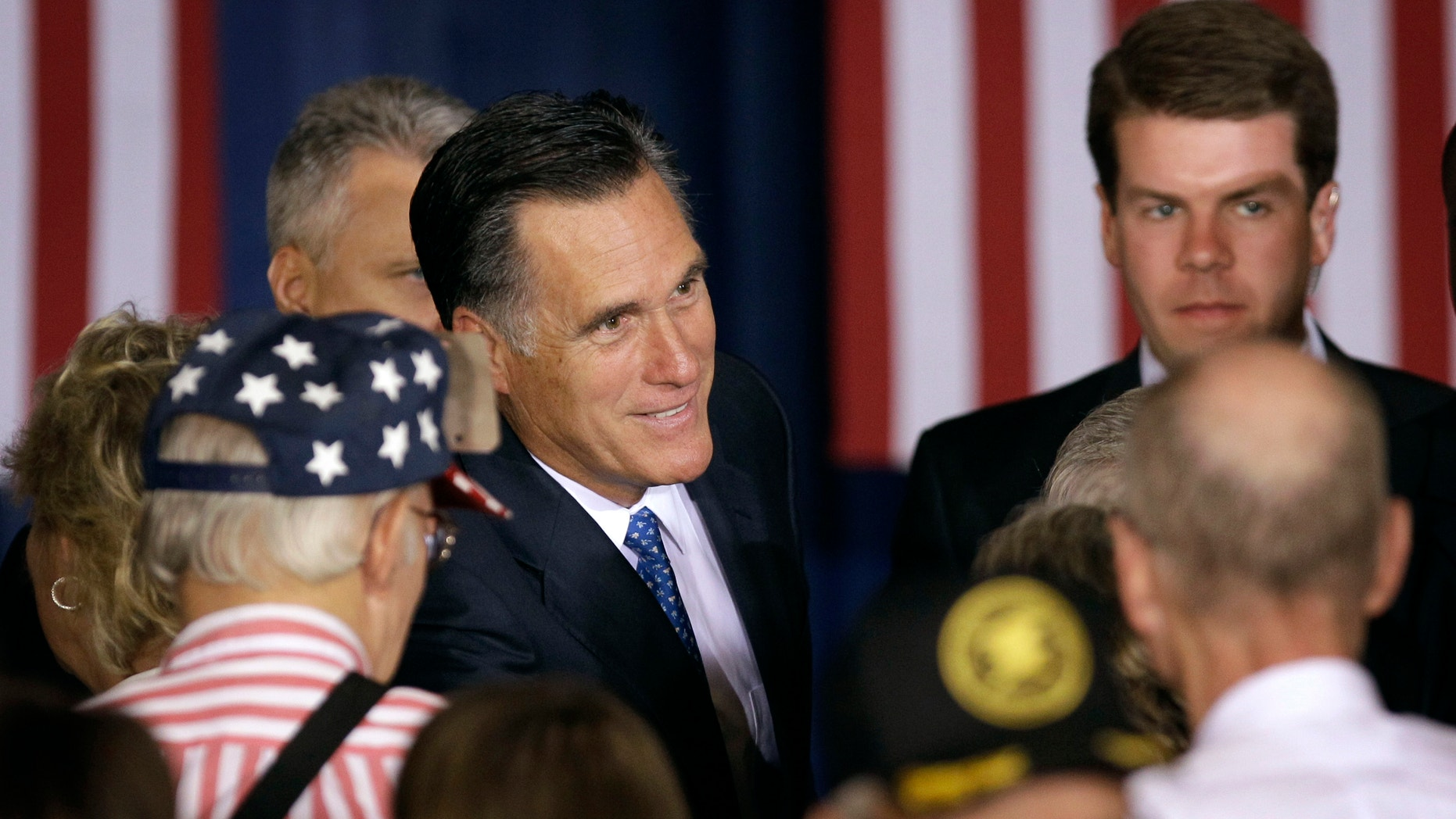 May 15, 2012: Republican presidential candidate, former Massachusetts Gov. Mitt Romney greets supporters after speaking at a campaign stop.