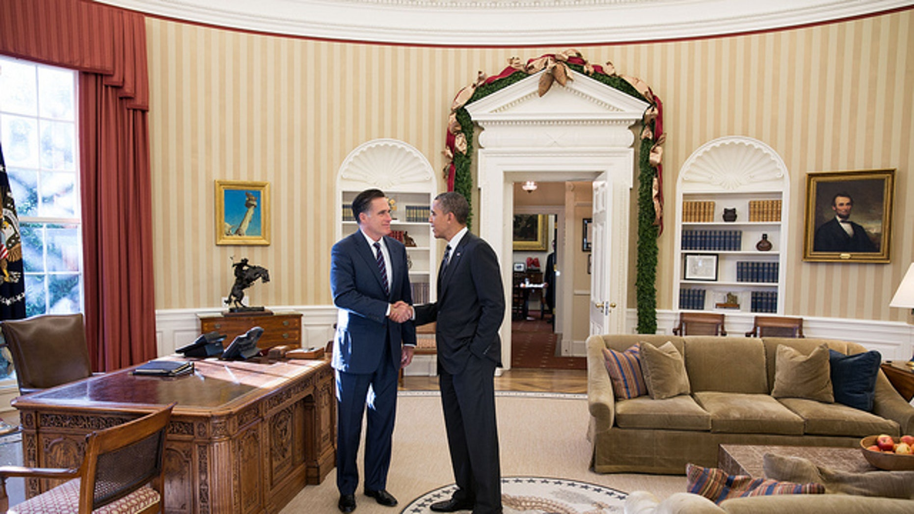 Nov. 29, 2012: President Obama and former Massachusetts Gov. Mitt Romney talk in the Oval Office following their lunch.
