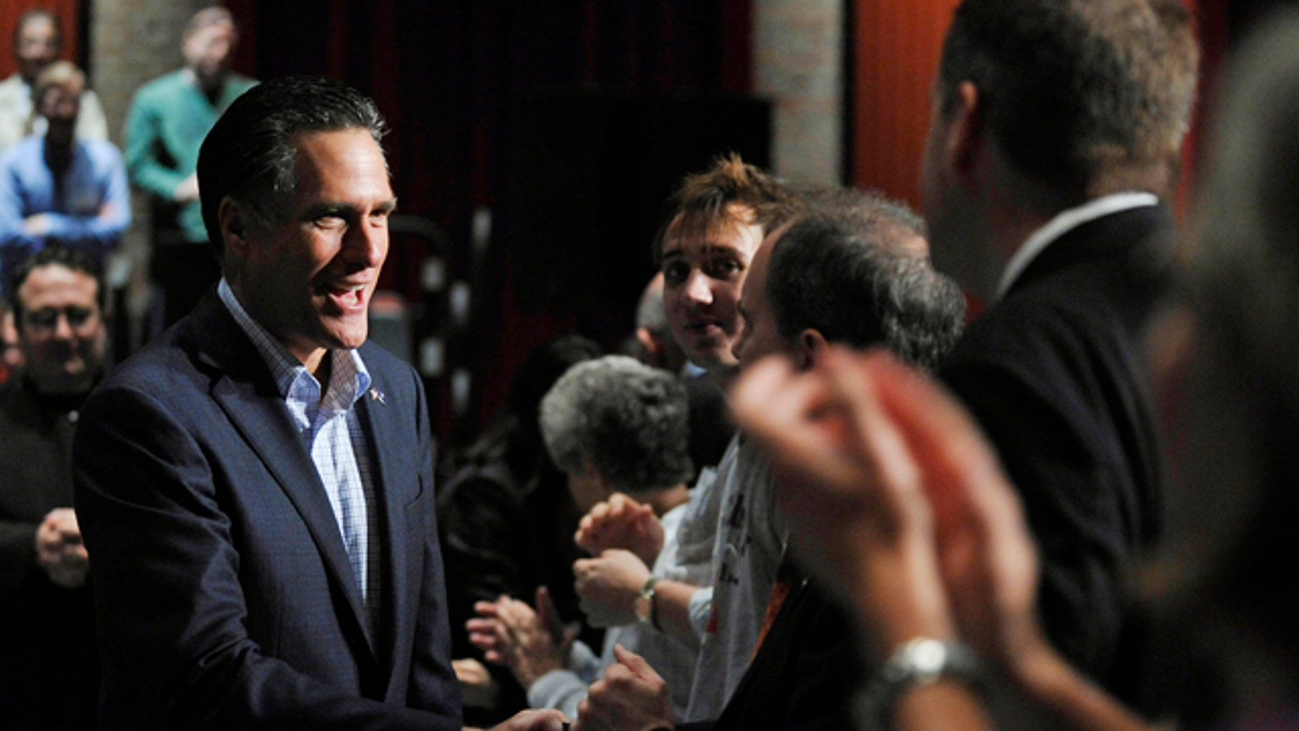 Dec. 17, 2011: Republican presidential candidate and former Massachusetts Gov. Mitt Romney greets supporters during a town hall meeting at Memminger Auditorium in Charleston, S.C.