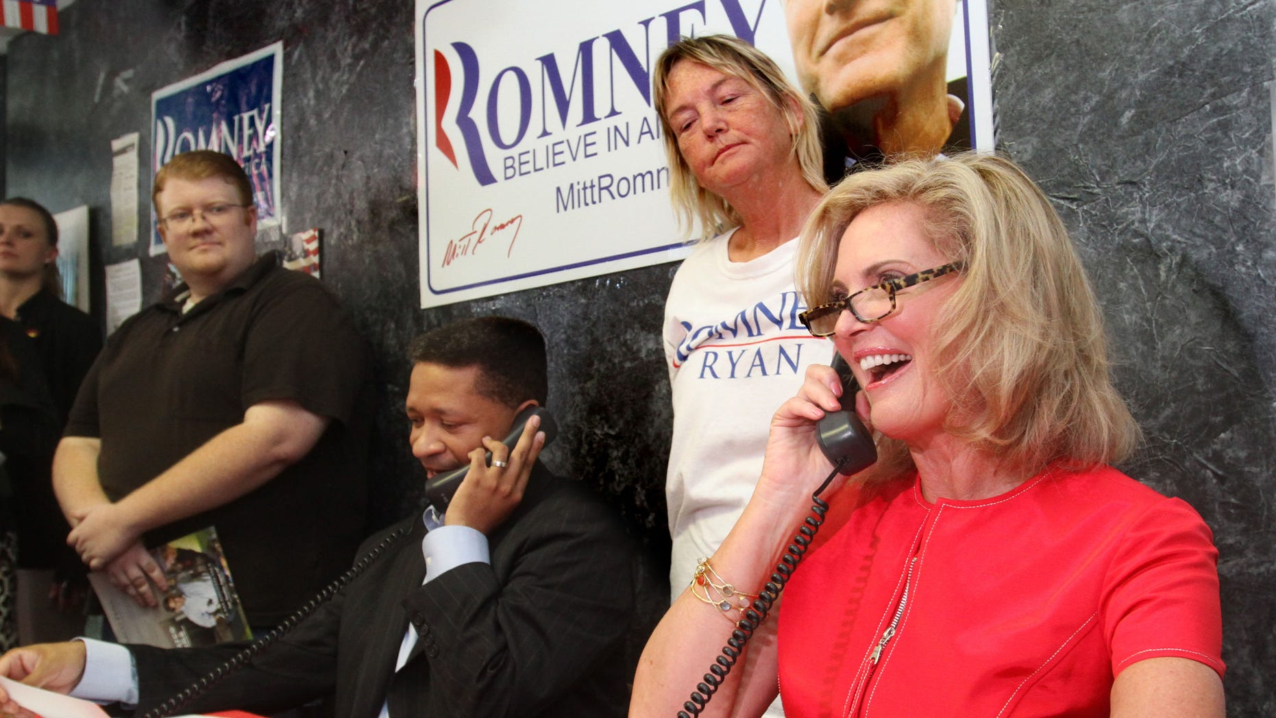 Saturday, Oct. 6,  2012: Ann Romney, wife of Mitt Romney, works the phones with former high-profile Democrat Artur Davis, left, and volunteer Sarah Frazee at the Orange County Victory Office in Orlando, Fla.