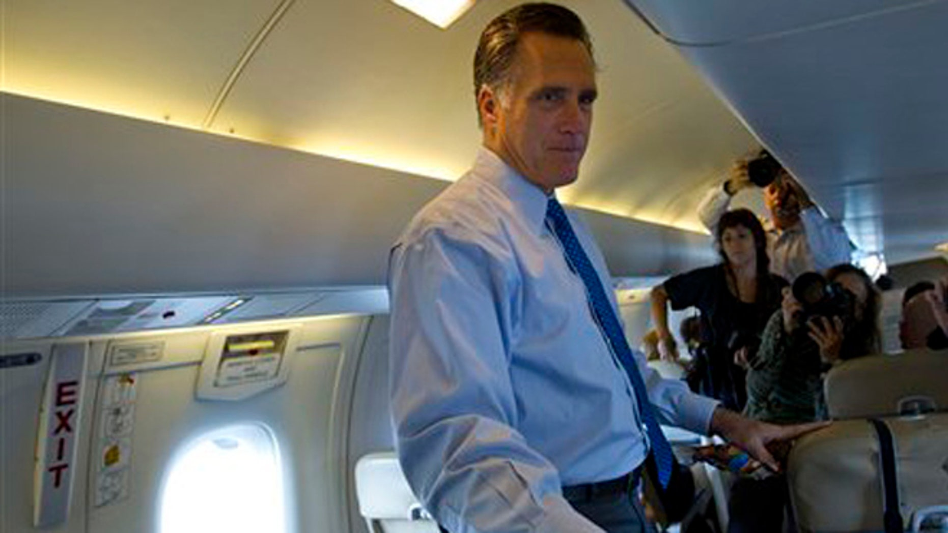 Aug. 18, 2012: Republican presidential candidate Mitt Romney talks to reporters during a flight to Hyannis-Barnstable Municipal airport in Hyannis, Mass.
